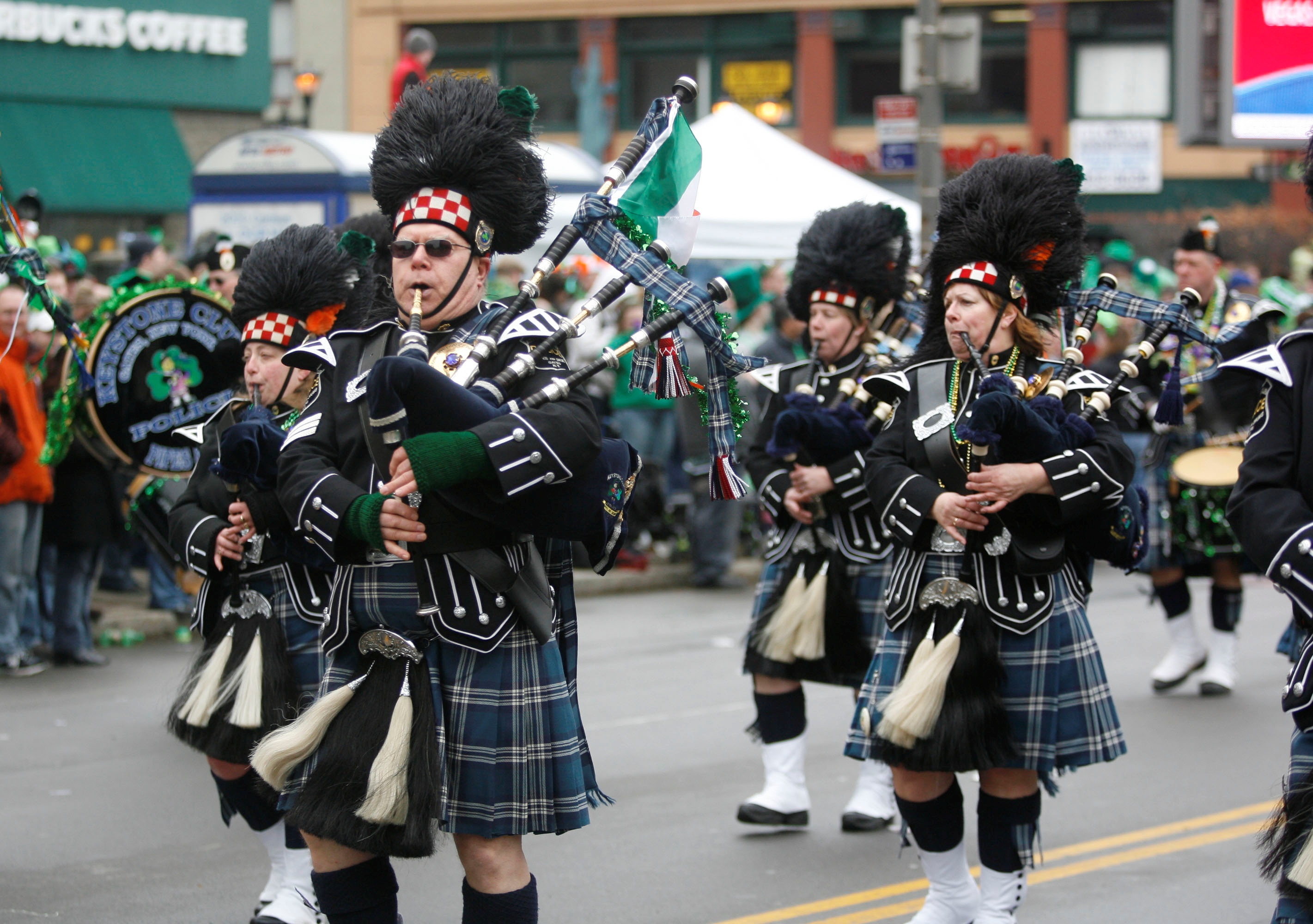 Keystone Club Police Pipe and Drum Corps of Gates  march  at Buffalo's 68th annual St. Patrick's Day Parade on  Delaware Avenue in Buffalo. (John Hickey/Buffalo News)