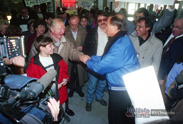 The author's father, Steve Cichon (dark glasses & mustache), about to shake hands with Jerry Brown at the Broadway Market in 1992. (Buffalo News archives)