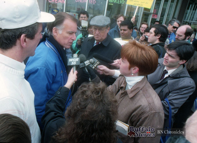 Presidential hopeful Jerry Brown speaks with Buffalo radio reporters Susan Rose of WBEN and George Richert of WWKB outside of the Broadway Market in 1992. (Buffalo News archives)