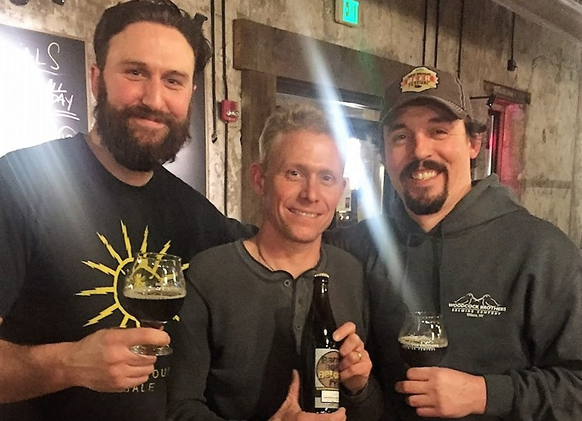 Jonathan Oakes, left,  Tim Woodcock and Matt Redpath show off the Barrel-Aged Belgian Rye. (Kevin Wise/Special to The News).