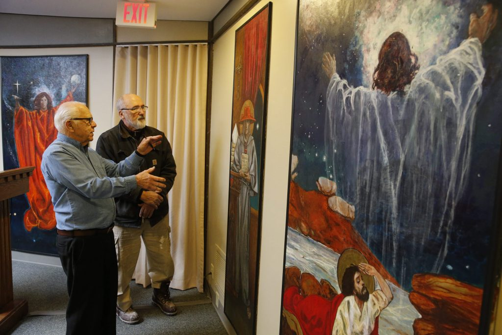 Art historian and restorer Henry Swiatek, right, points out the complex brush work in a painting by renowned Polish artist Jan Rosen in the chapel of St. Justin Rosary Hour Friary in Hamburg while examining the artwork with Fr. Marcel Sokalski, resident and archivist there, Thursday, March 17, 2016. (Derek Gee/Buffalo News)