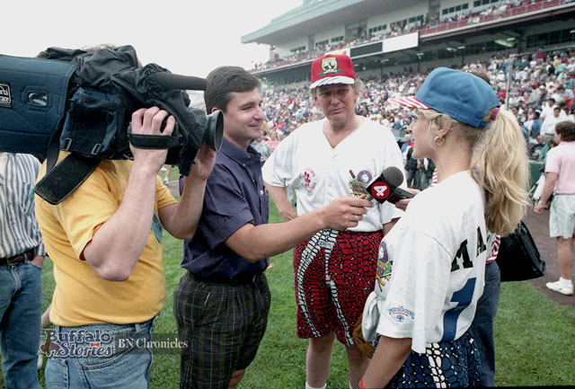 Channel 4 sports anchor Chuck Howard interviews Marla Maples and Donald Trump at Jim Kelly's Carnival of Stars in Downtown Buffalo in 1992. (Buffalo News archives)