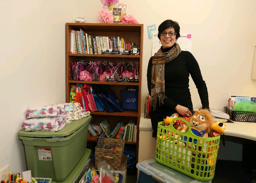 Madeline Gathers is the EPIC program director. Her downtown office is filled with supplies for several of the programs she runs, including the Just Teens program. (Sharon Cantillon/Buffalo News)