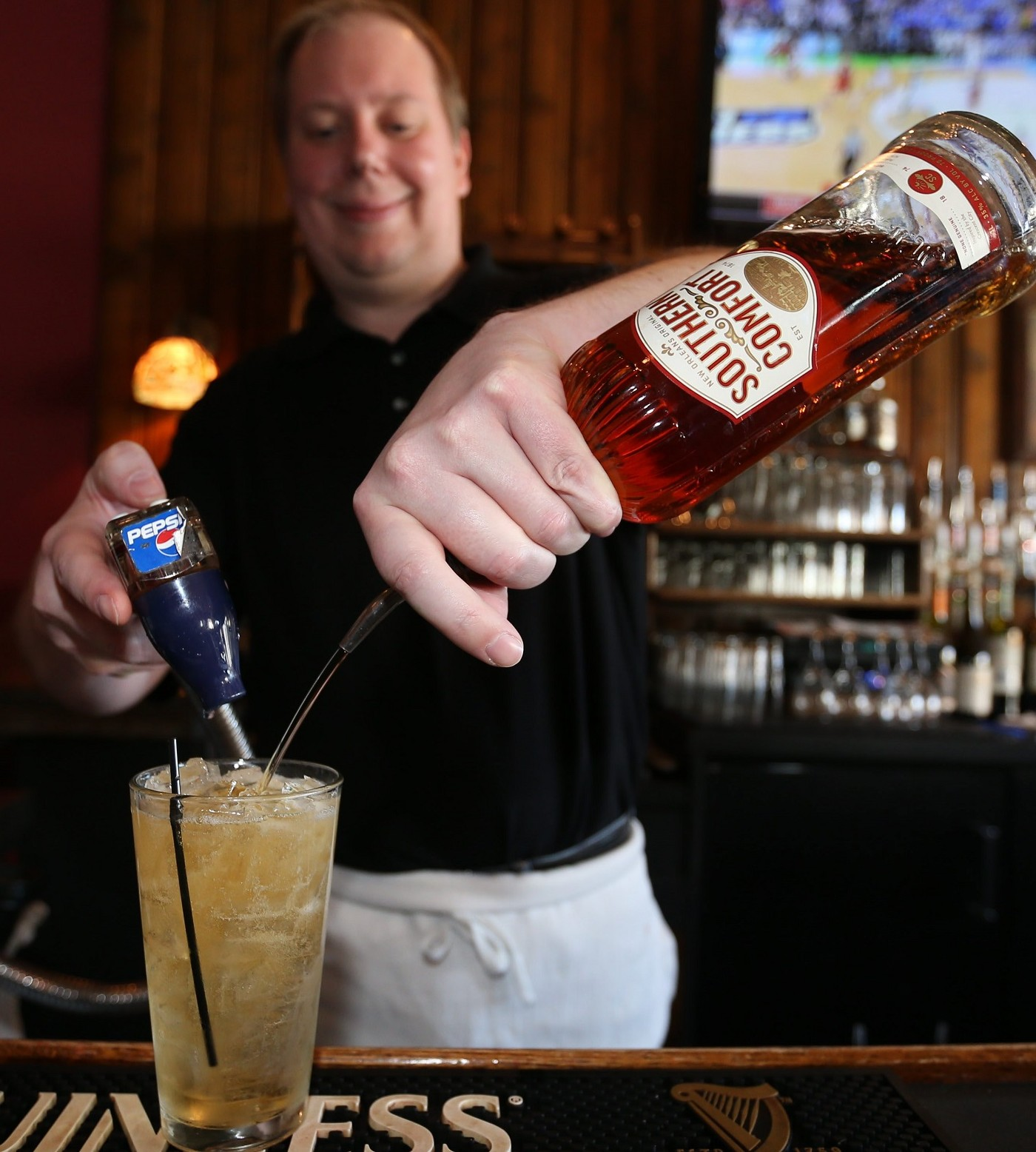 Loughran's is at 4543 Main St. in Snyder.  Bartender Kevin Kirwin makes a Souther Comfort an ginger, Saturday, March 19, 2016.  (Sharon Cantillon/Buffalo News)