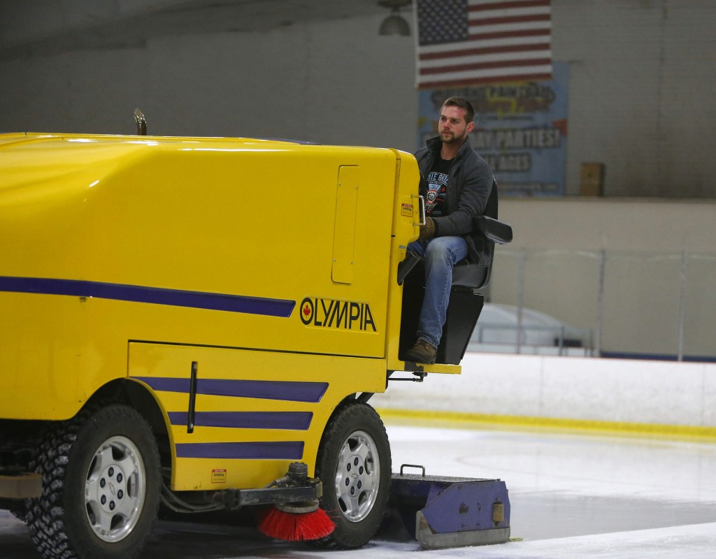 Bernie Sanders supporter Glenn Laben clears the ice at Holiday Twin Rinks in Cheektowaga. (Mark Mulville/Buffalo News)