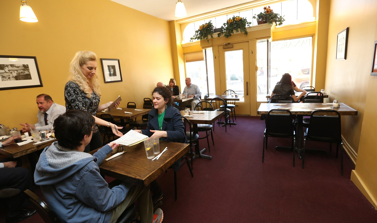 Lynn Panaro takes the order from Blaine Lapin, left, and Danielle Guttman at Delaware Avenue Italian restaurant Panaro's.  (Sharon Cantillon/Buffalo News)