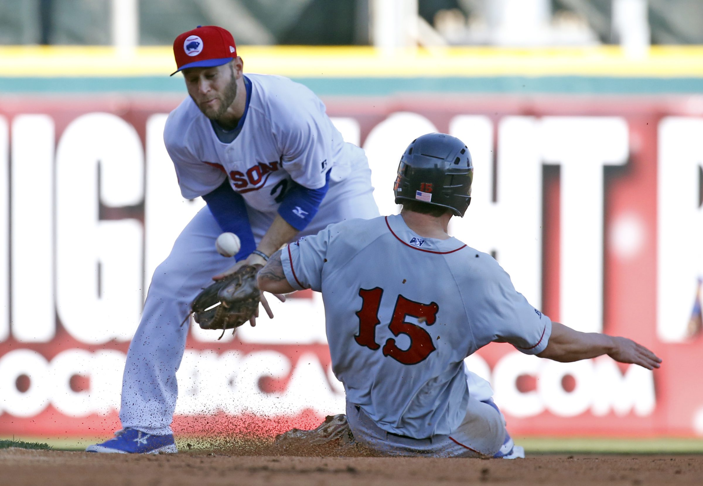 Buffalo Bisons David Adams cannot handle a ball on a steal attempt by Pawtucket Red Sox Sa Travis during 2nd inning action at Coca-Cola Field on Saturday, April 16, 2016. (Harry Scull Jr./Buffalo News)