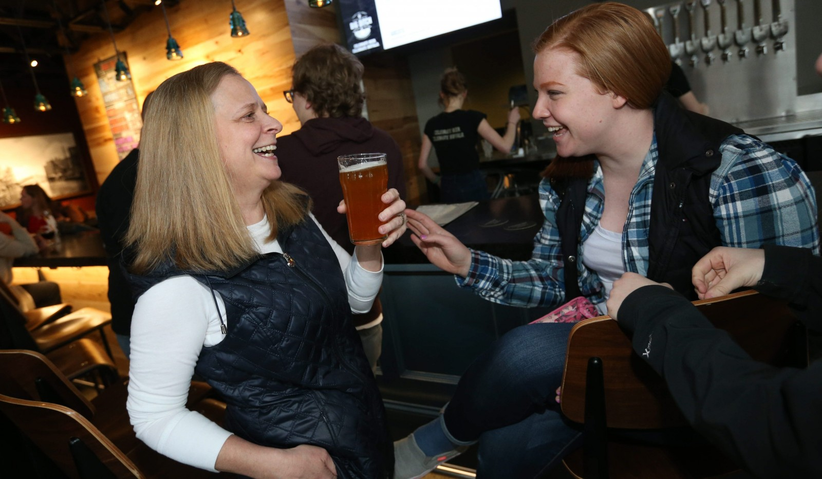 Colleen Bohn of Ellicottville has a Low Bridge while hanging out with her daughters, Mary, center and Kelsey at Big Ditch Brewing Company. (Sharon Cantillon/Buffalo News file photo)