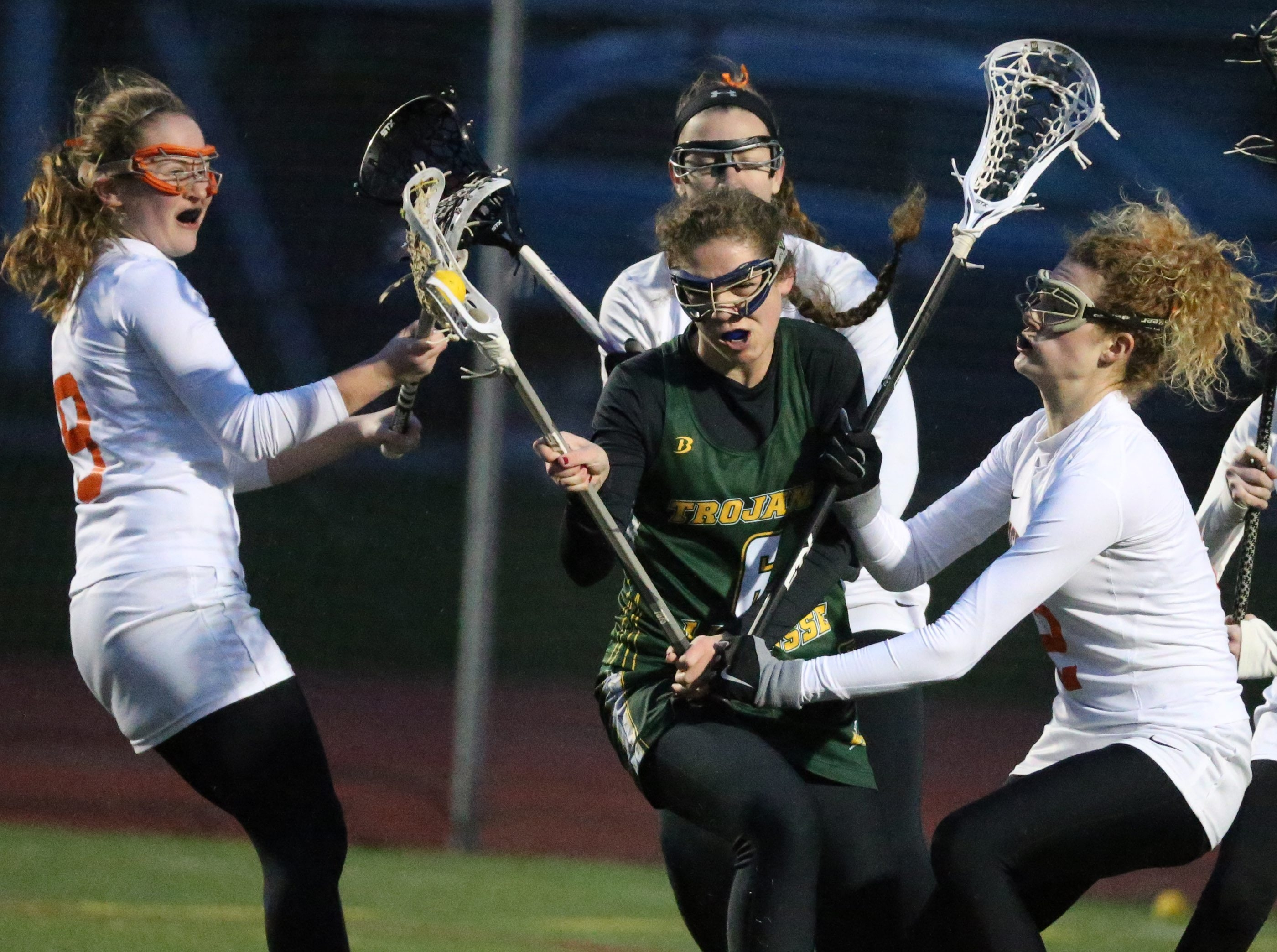 Amherst's defense battles West Seneca East's Laura Skrzypczyk in the first half of their lacrosse game Wednesday night. Amherst won, 14-4.