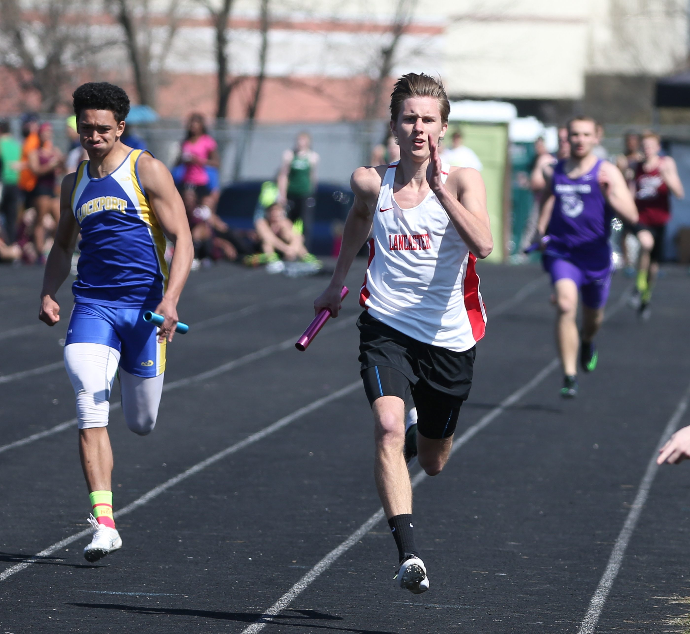Jesse Kucewicz runs anchor for Lancaster in its 4x200 relay win at the Cheektowaga Warrior Relays. Lancaster won in a record time of 1:31.3.