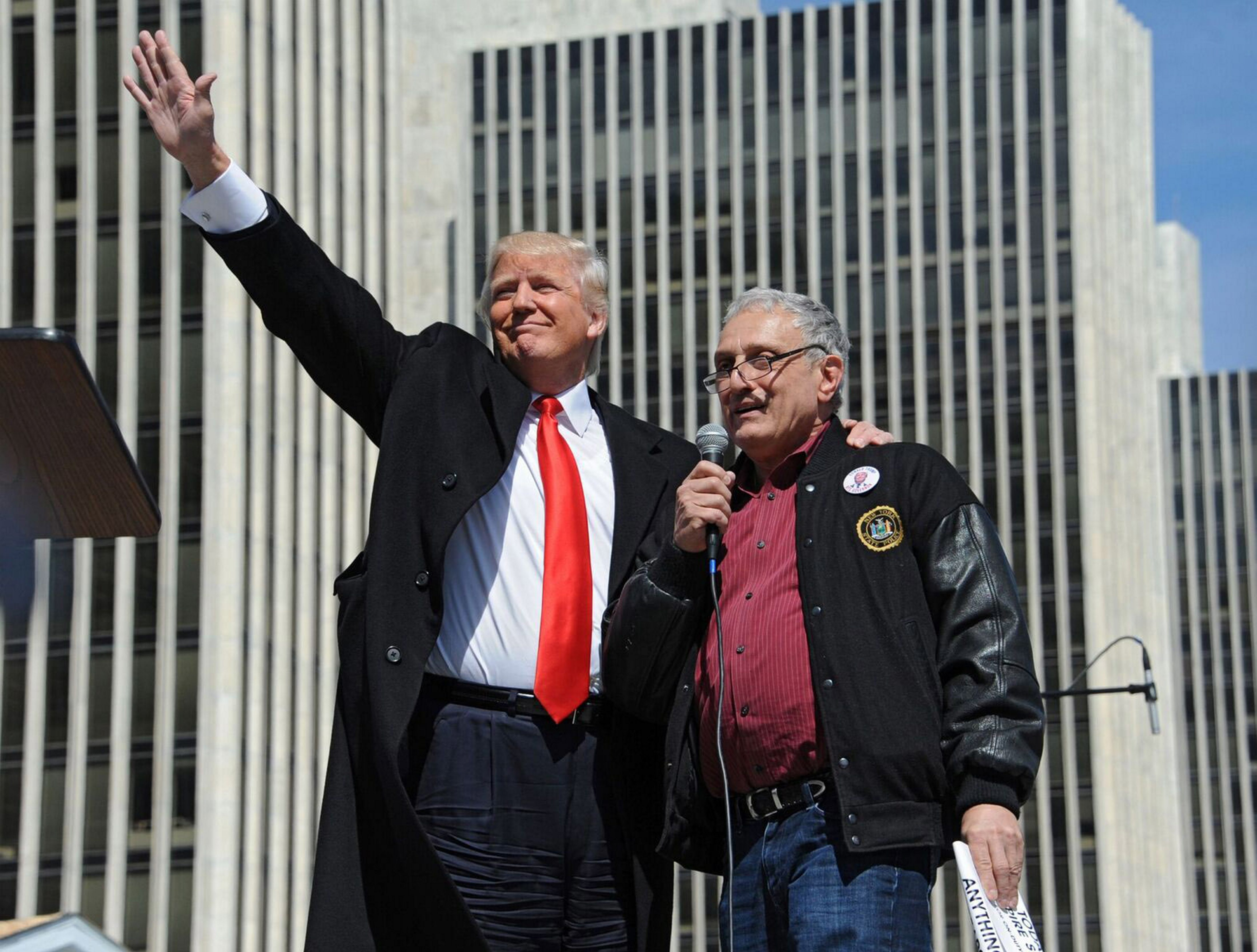 With Carl Paladino at the microphone, Donald Trump acknowledges crowd at Empire State Plaza in Albany in April 2014 at a Second Amendment rally seeking the repeal of SAFE Act gun-control law signed by Gov. Andrew M. Cuomo.