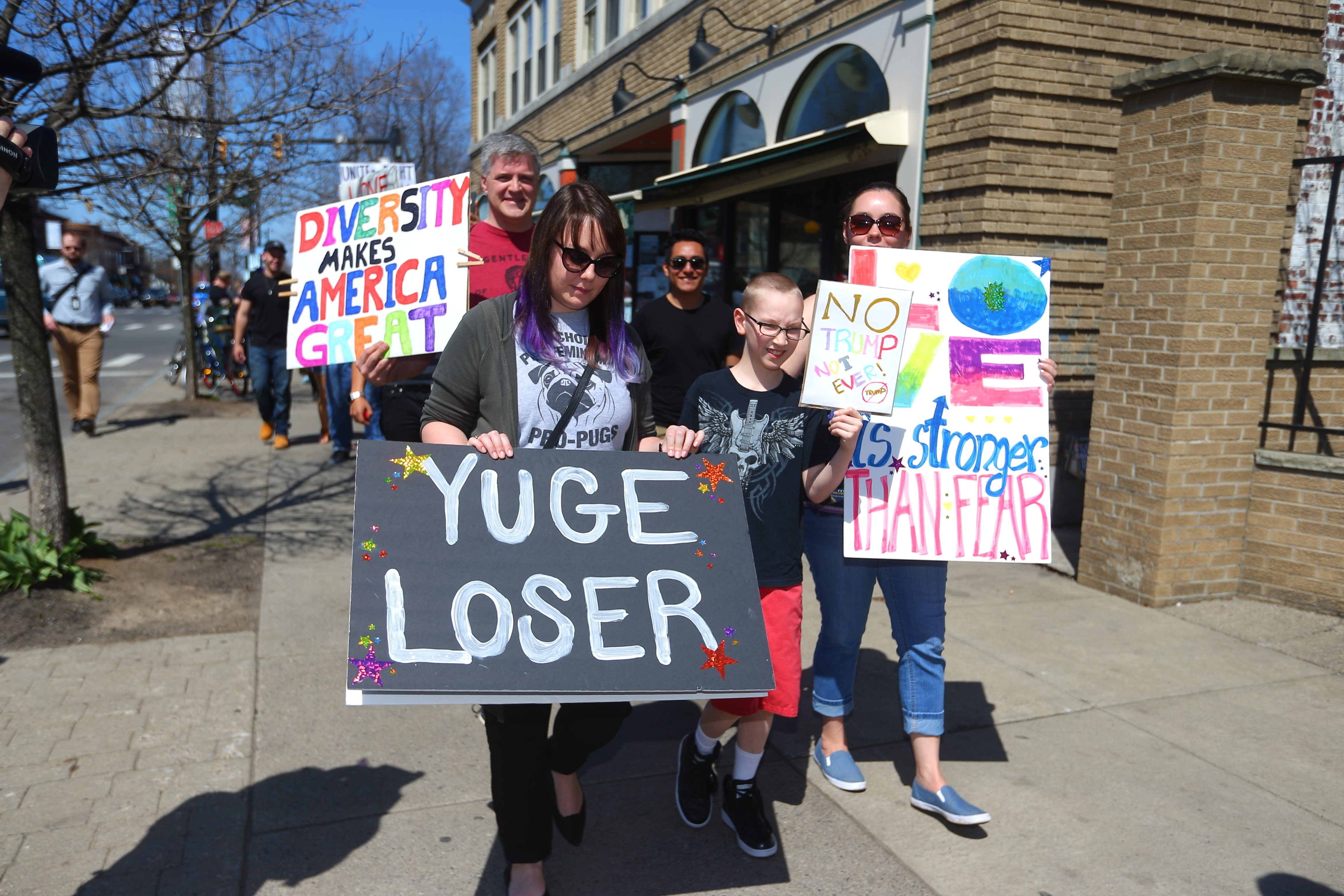 Marchers gathered for a anti Donald Trump rally, met at Bidwell Park and marched down Elmwood to Allentown in Buffalo, N.Y., on Sunday April 17, 2016. (John Hickey/Buffalo News)