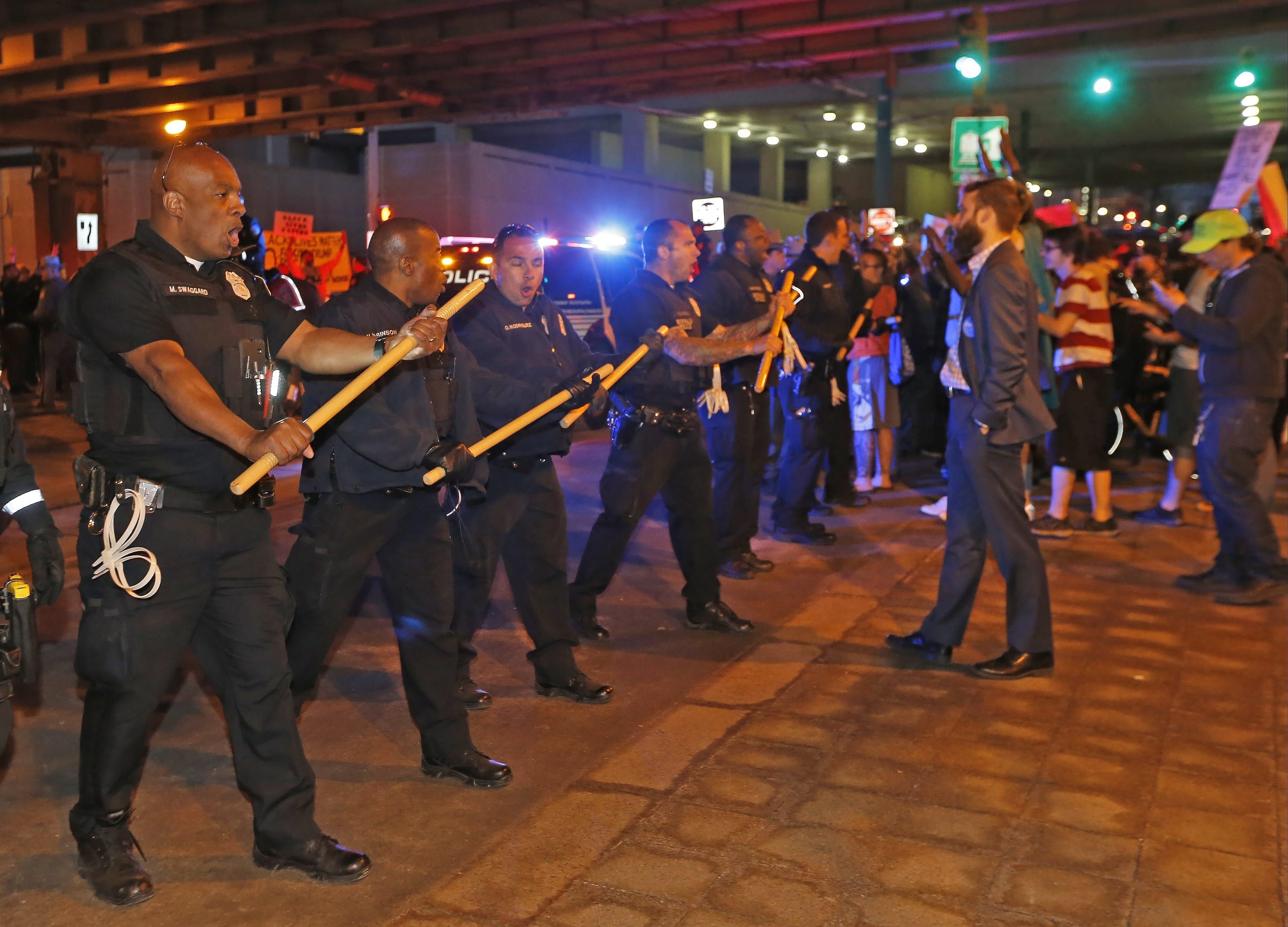 Police form a line to push protesters back so that the Metro Rail in Buffalo can proceed as protesters tried to block it at Exchange and Main on Monday, April 18, 2016. (Robert Kirkham/Buffalo News)