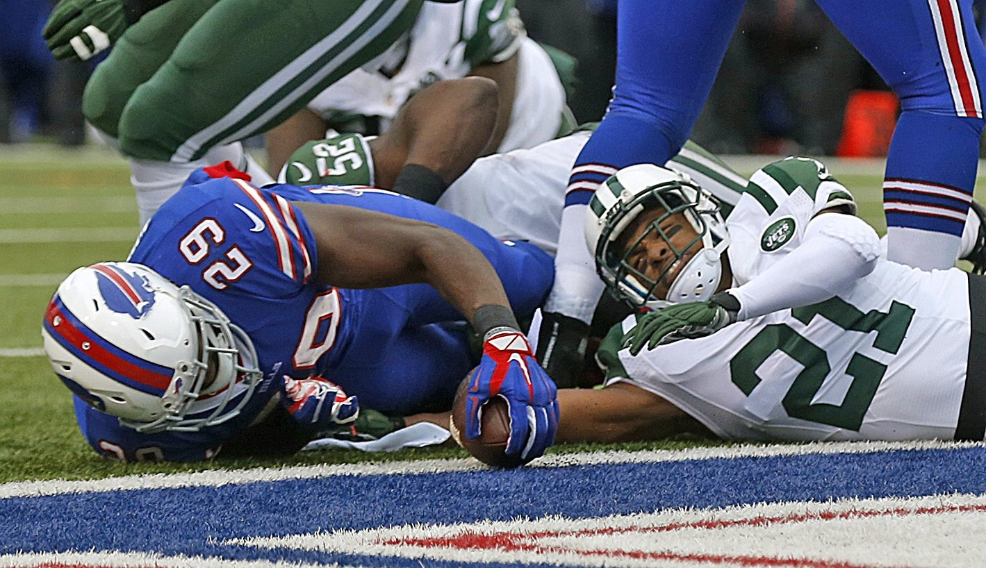 The Bills scored a win over the Jets on the field in the teams' season finale on Jan. 3. Here Karlos Williams runs in for a TD.