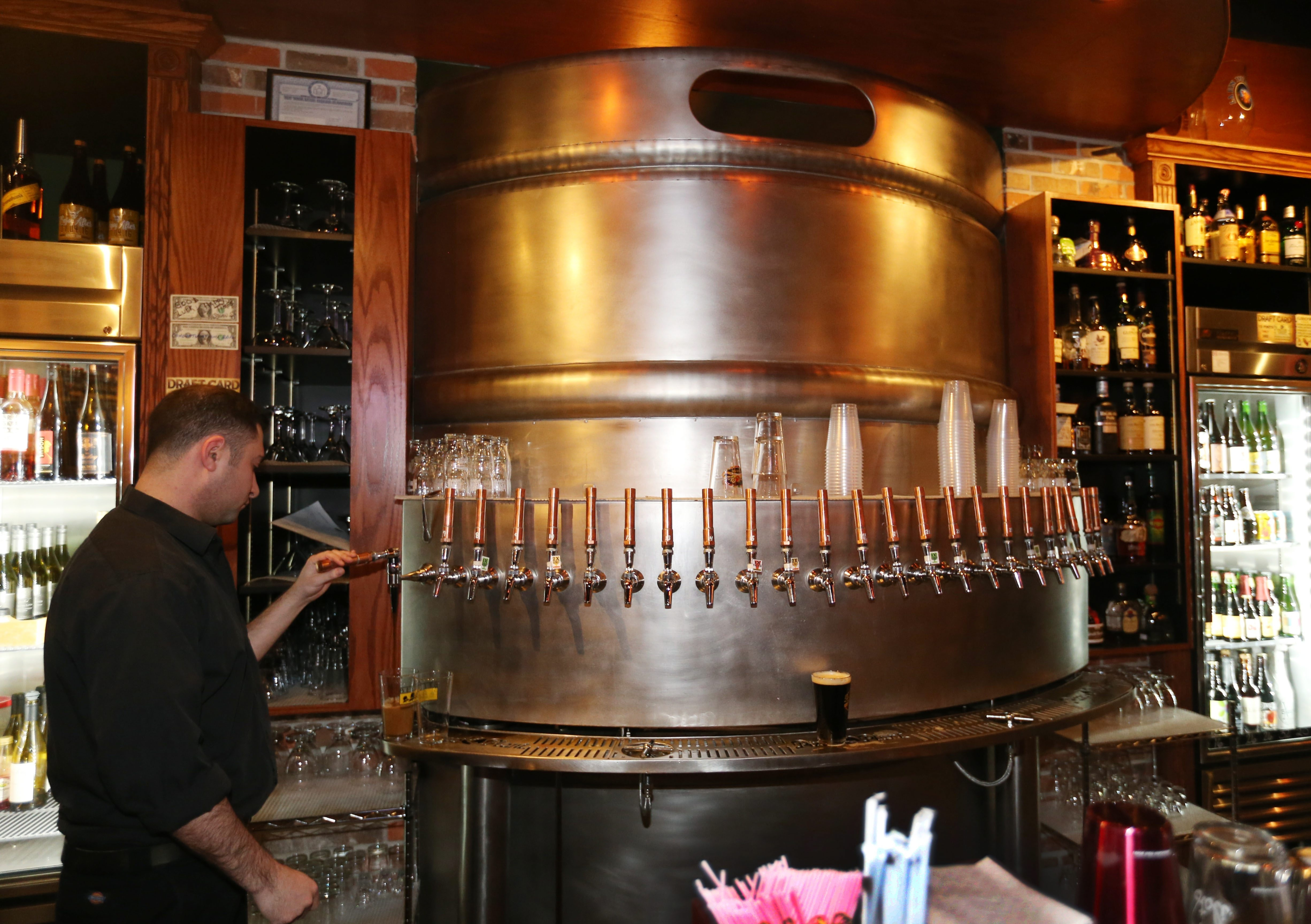 Pizza Plant Italian Pub on the ground floor next to the Courtyard Marriott at 125 Main St. in downtown Buffalo. Their beers are housed in what appears to be a giant keg. (Sharon Cantillon/Buffalo News file photo)