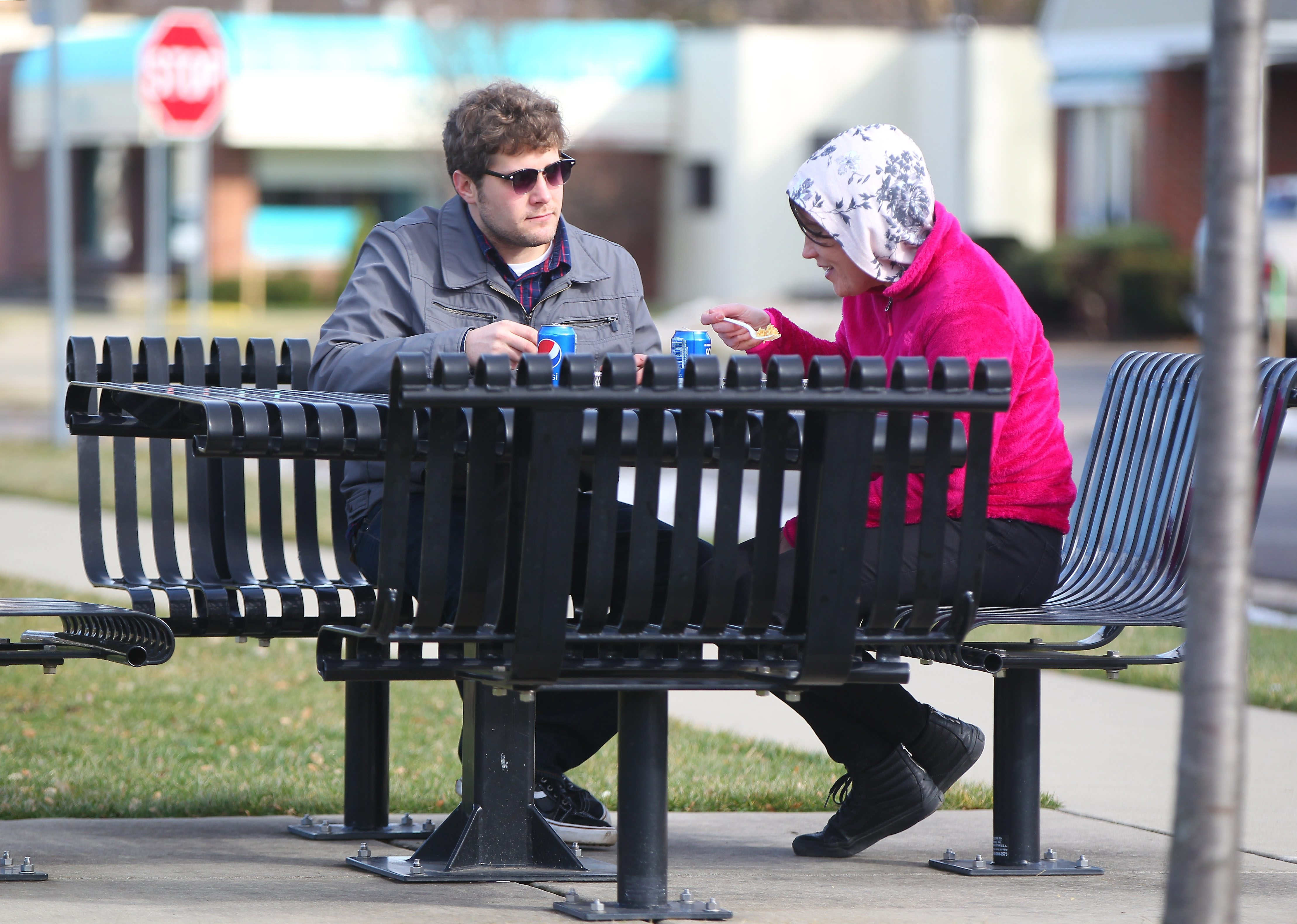 Shawn Heltz and Megan Lasker enjoy their lunch outside on a mild day in Hamburg Monday, February 1, 2016.   (Mark Mulville/Buffalo News)