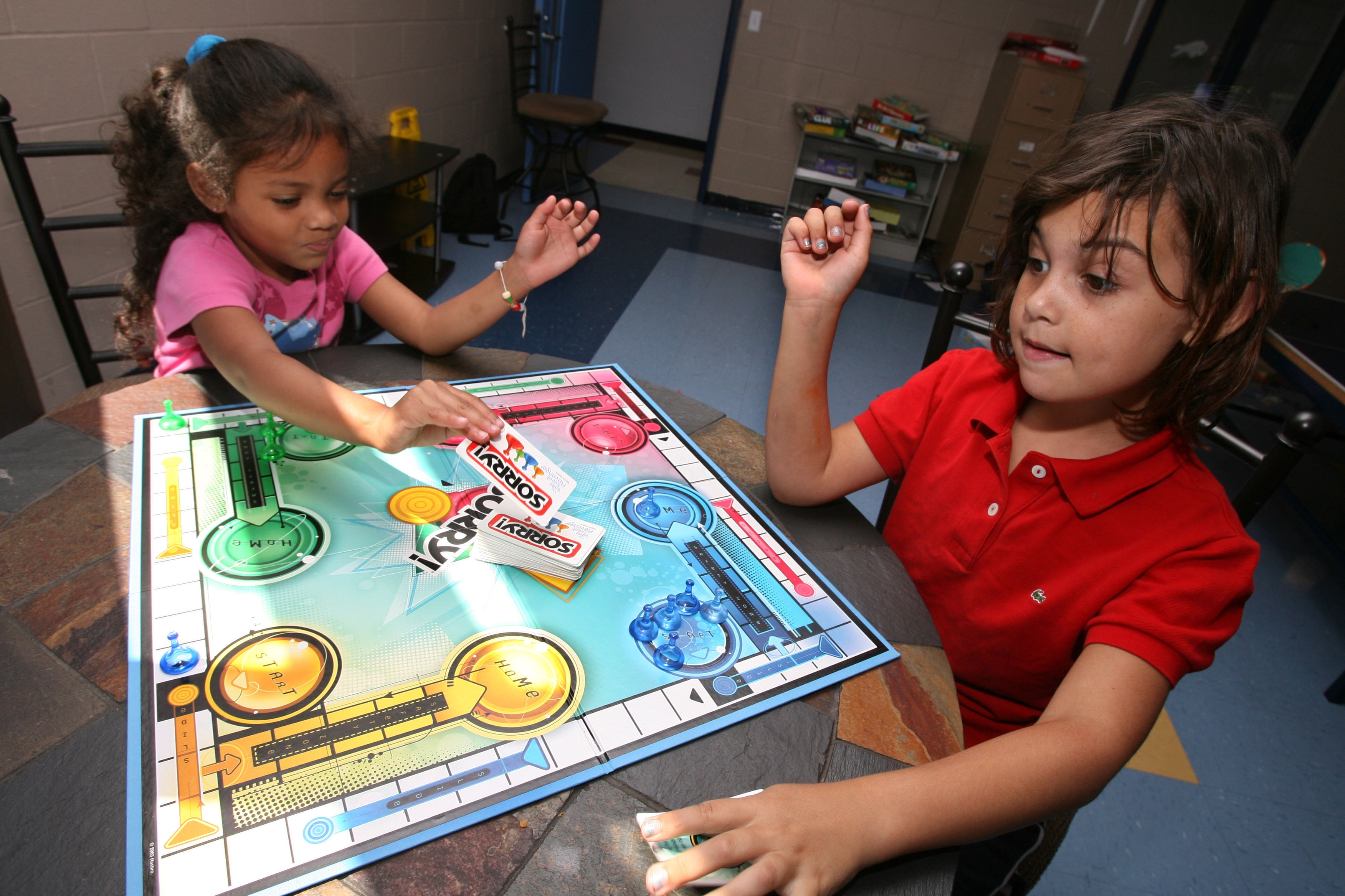 """FOR CITYSIDE:  Lissetly (cq) Garcia, 6, left, and Christina Maue, 7, play a game of """"Sorry!"""" at Camp Adventure, a joint day camp program at the Belle Center, in conjunction with the Dream Center, on Maryland St. in Buffalo, Tuesday July 15th, 2008.  PHOTO BY CHARLES LEWIS"""