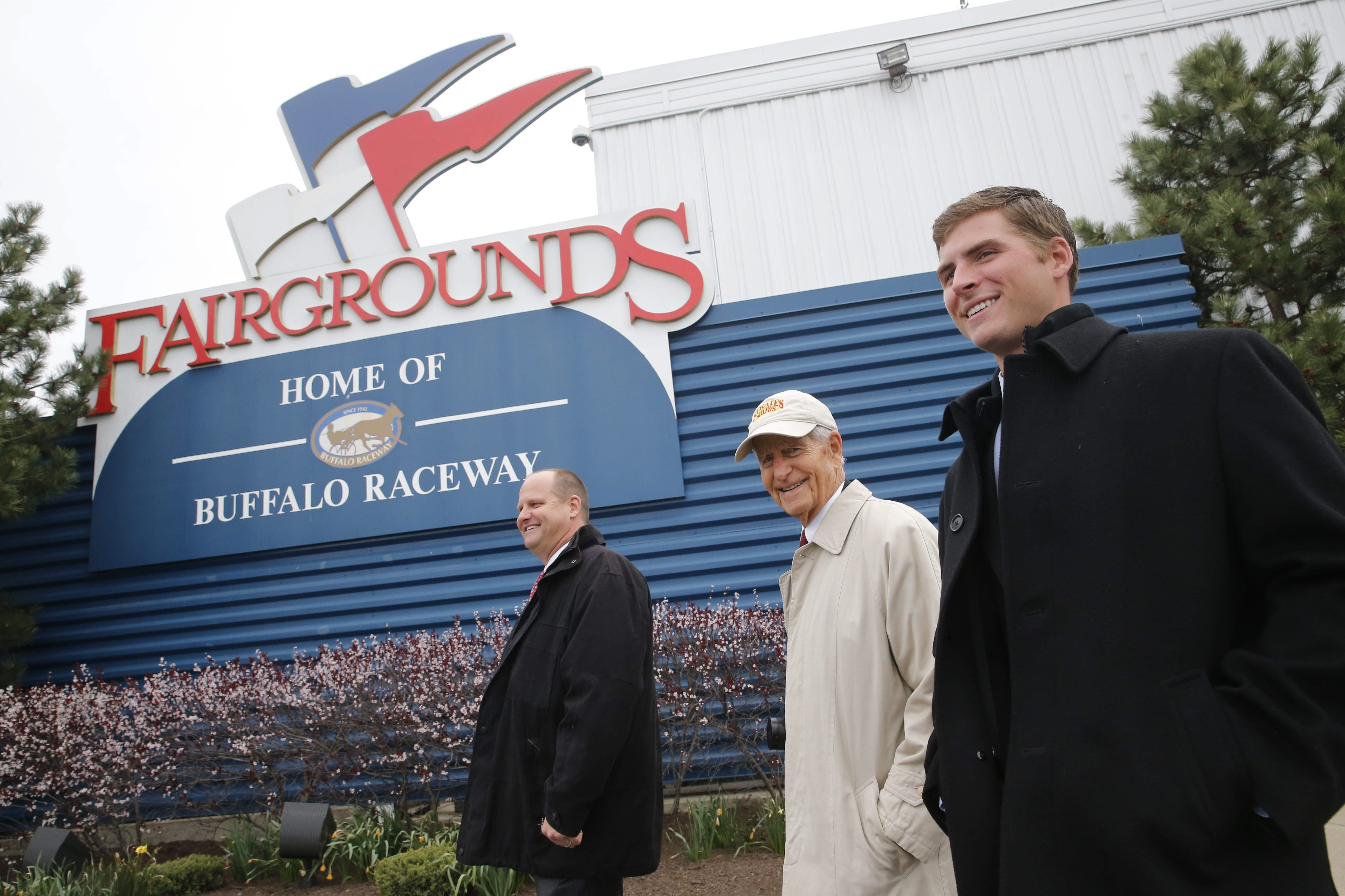 Three generations of the Strates family, from left, John Strates, E. James Strates and Nick Strates, who have provided the carnival for the Erie County Fair since 1924, walk on the fairgrounds following an event to mark the signing of a new 10-year contract to continue their relationship with the Erie County Agricultural Society, Friday, April 29, 2016.  ()