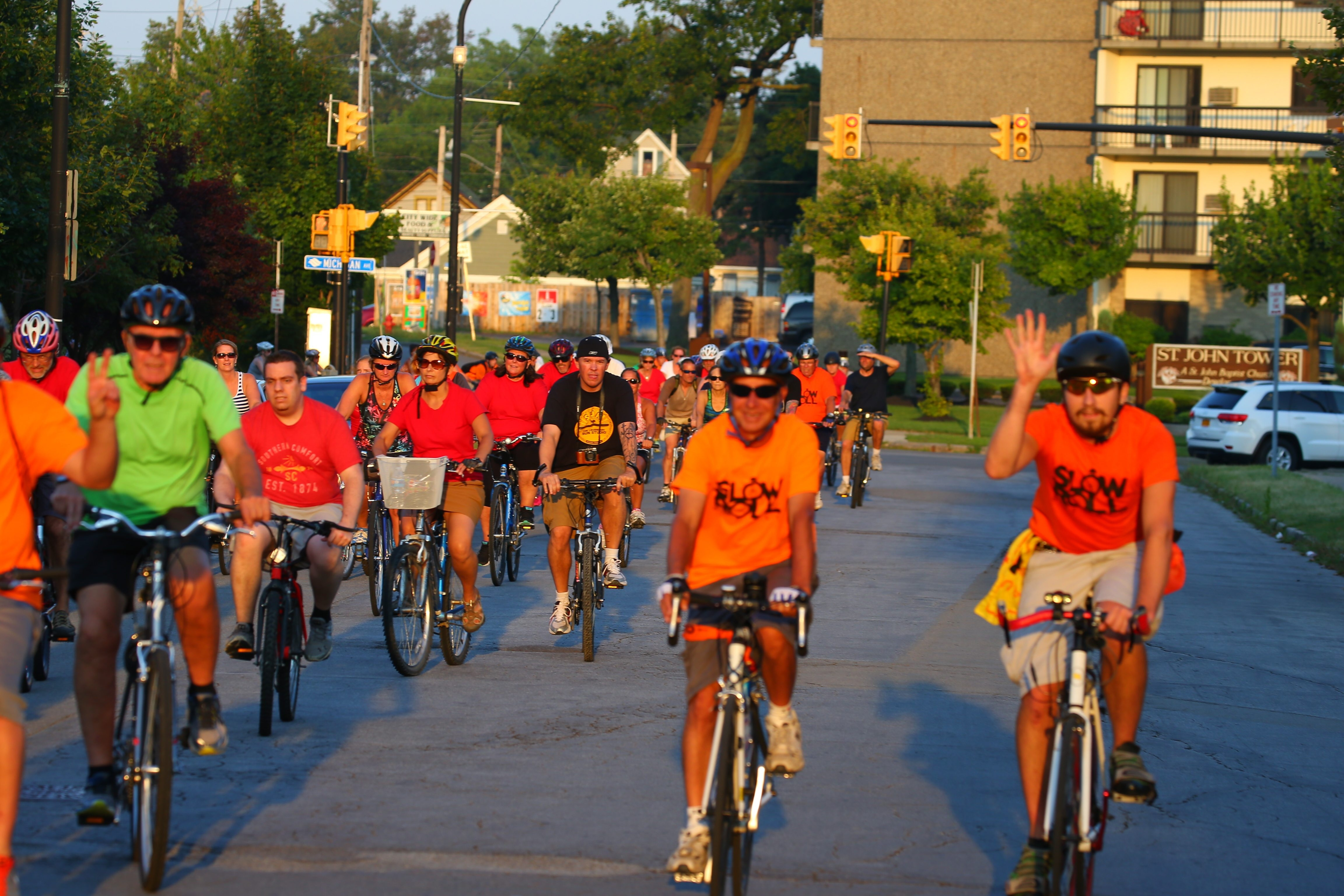 """Slow Roll Buffalo bicyclists ride down Virginia Street past Roswell Park Cancer Institute  as they move through city streets and neighborhoods in Buffalo on Aug. 17, 2015. The Slow Roll event kicks off May 8 with a """"Parkway Revival Ride.""""  (John Hickey/Buffalo News)"""
