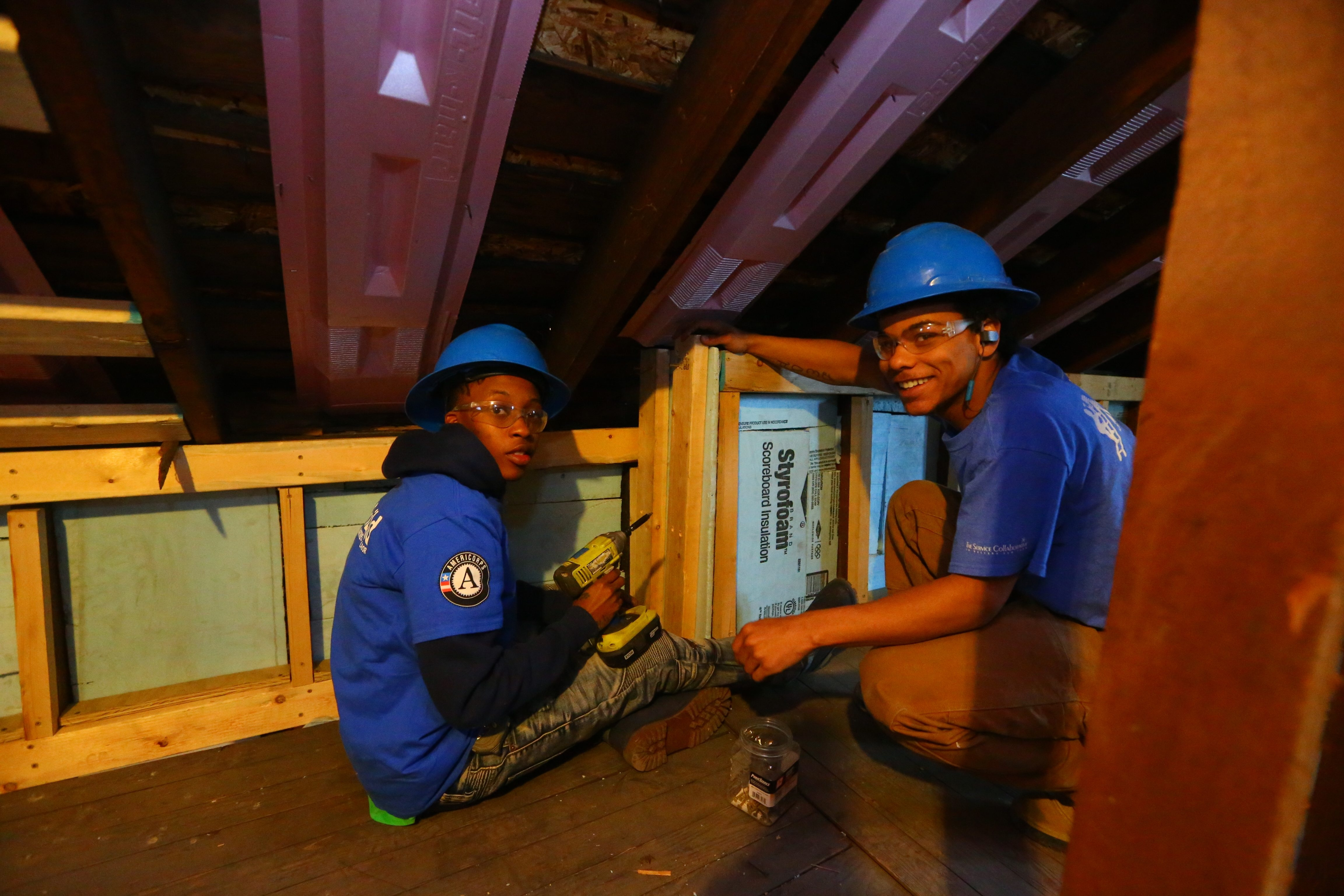 """I'm learning. I thought I knew everything,"" says Sean Norfolk, 19, right, as he works with Lameshae Scott, 23, at a Habitat site on LaSalle. (John Hickey/Buffalo News)"