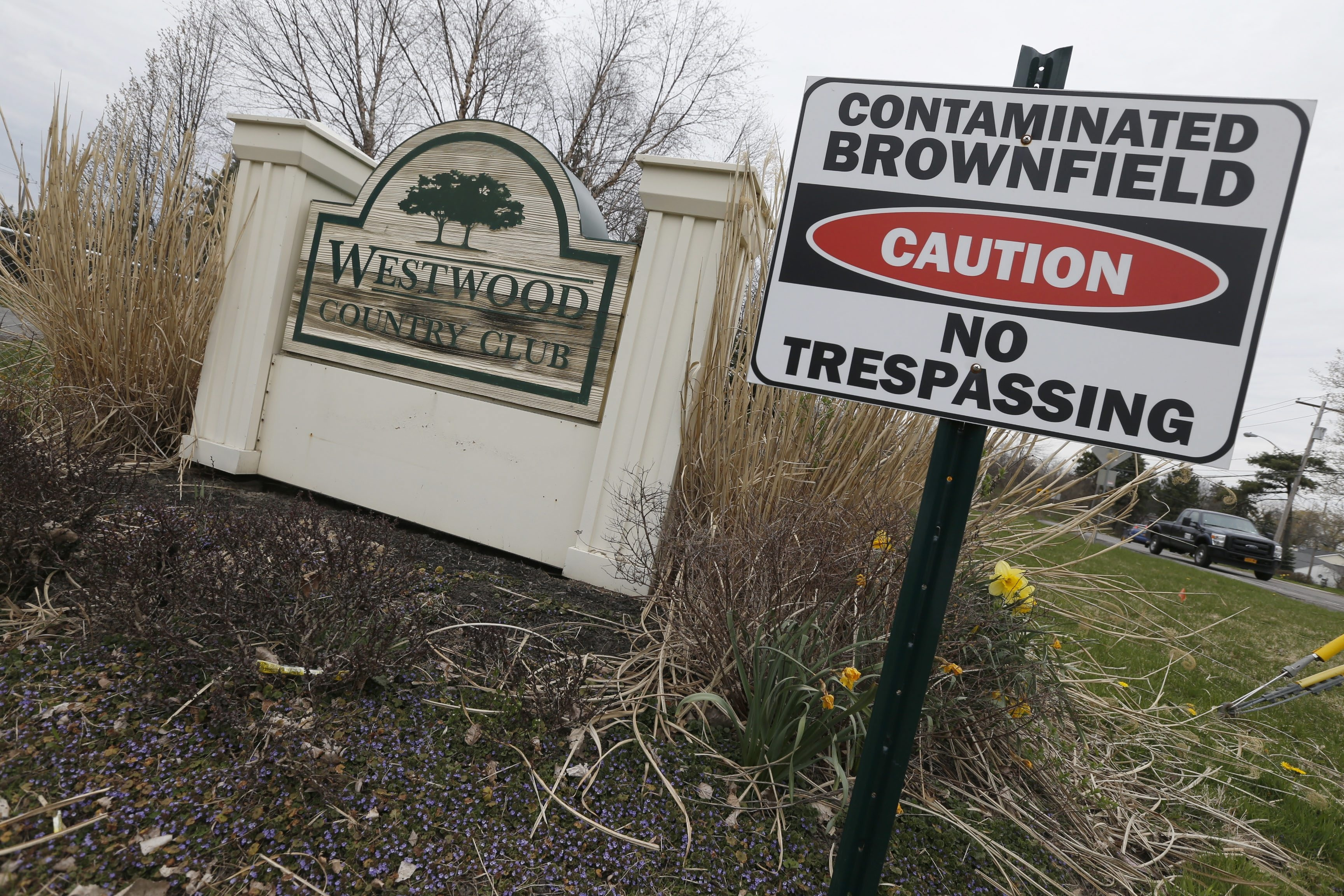 Signs outside the former Westwood Country Club sum up the land's past and present.