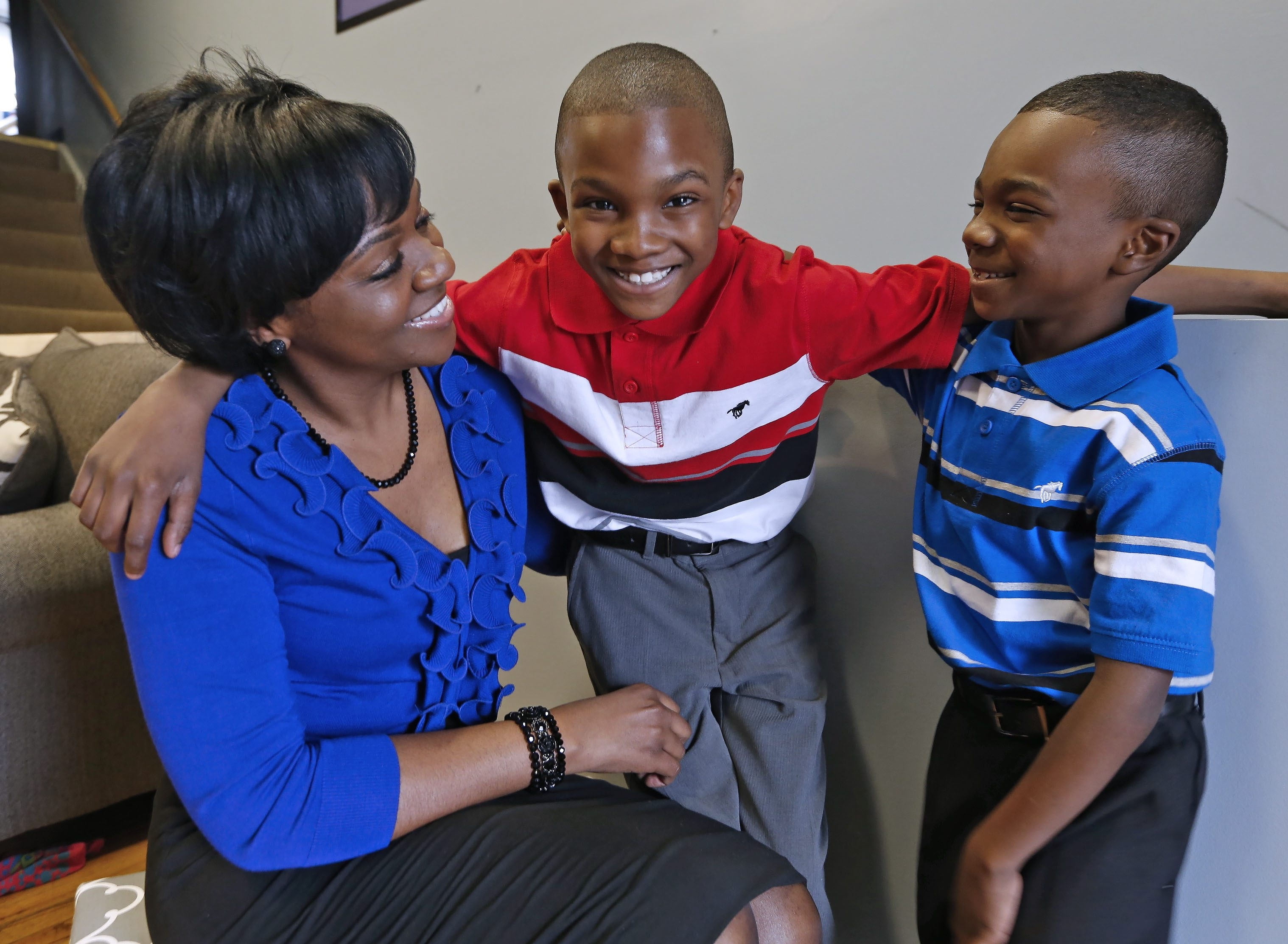 """David """"Tre"""" Hall, 10, in red shirt, is seen with his mom, Melissa, and brother Aiden, 6, in their Cheektowaga home on April 10."""