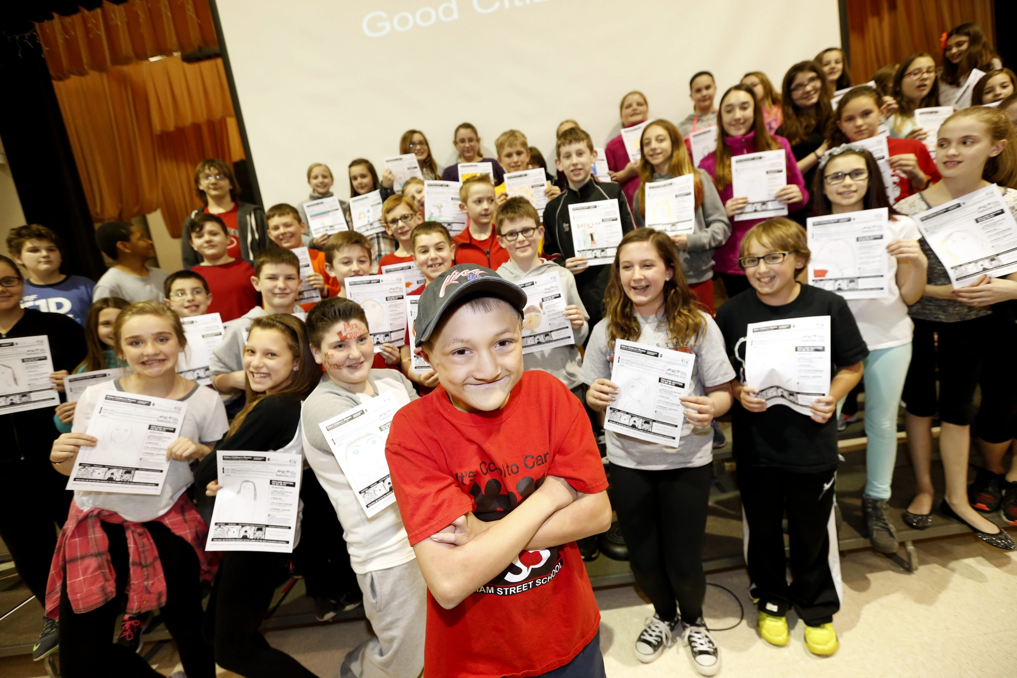 Ryan Patota, 10, front and center, and classmates in the Good Citizens Club at William Street School in Lancaster display self-portraits to be included in a mosaic at the new John R. Oishei Children's Hospital.