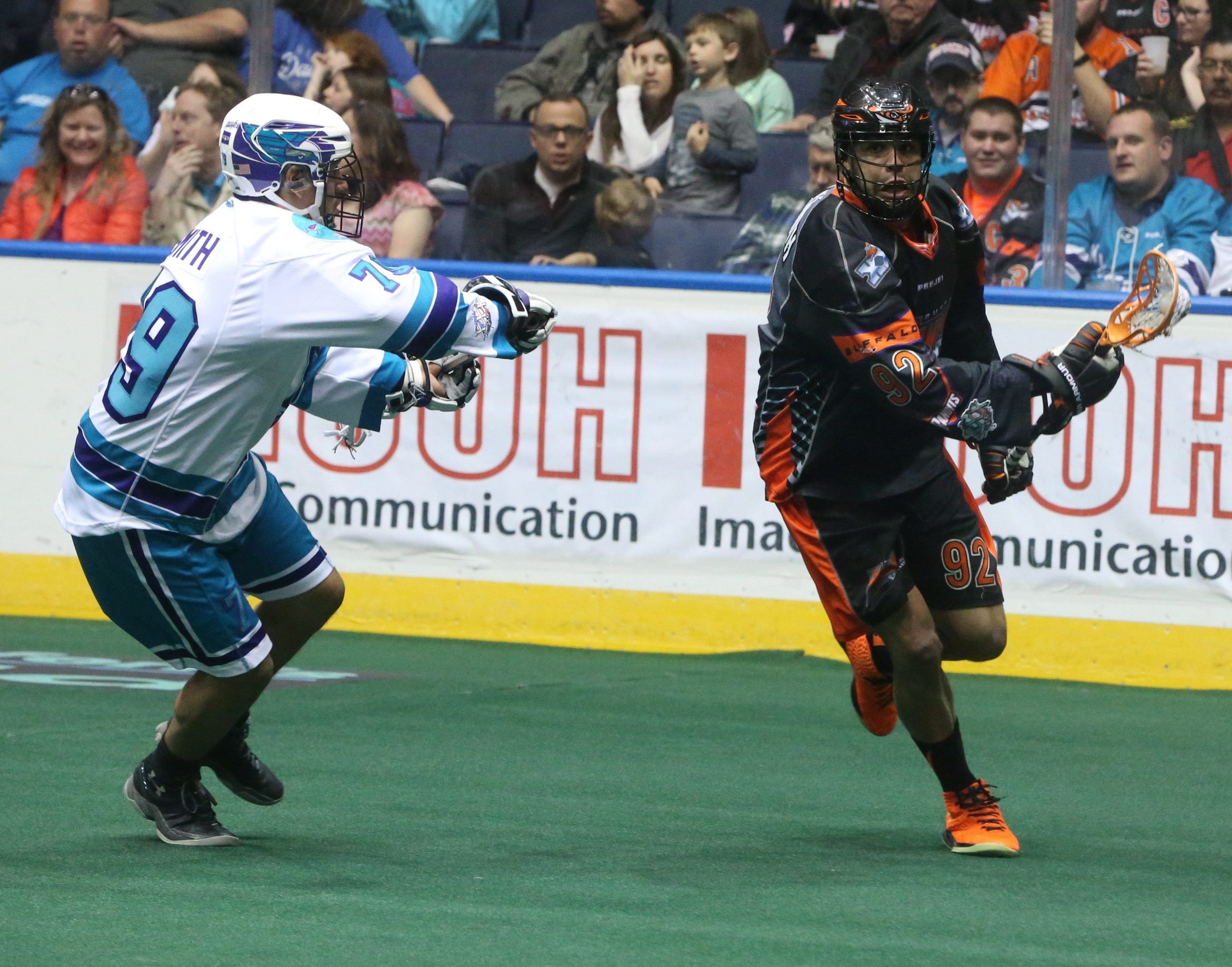 The Bandits' Dhane Smith works around the defense of Rochester's Sid Smith on Saturday. Smith had four goals and four assists on the night.