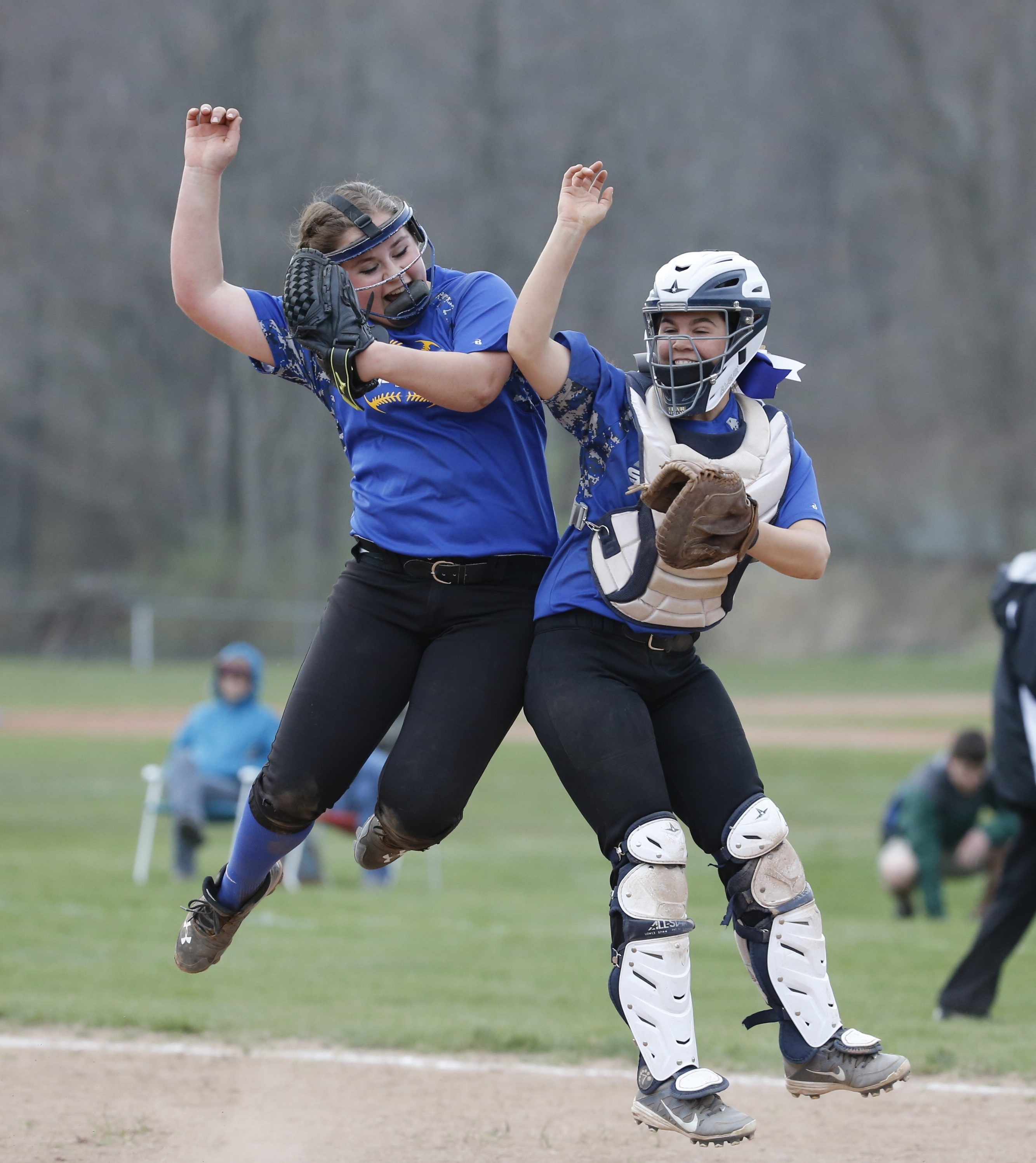 Brooke Strausbaugh and catcher Victoria Adkins celebrate Alden's 7-0 win over Holland.