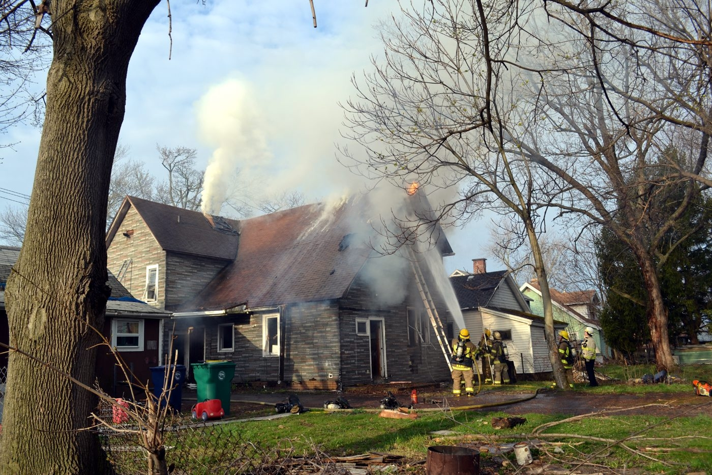 Firefighters battle a house fire on Pierce Avenue in Niagara Falls on Thursday. (Larry Kensinger/Contributer art)