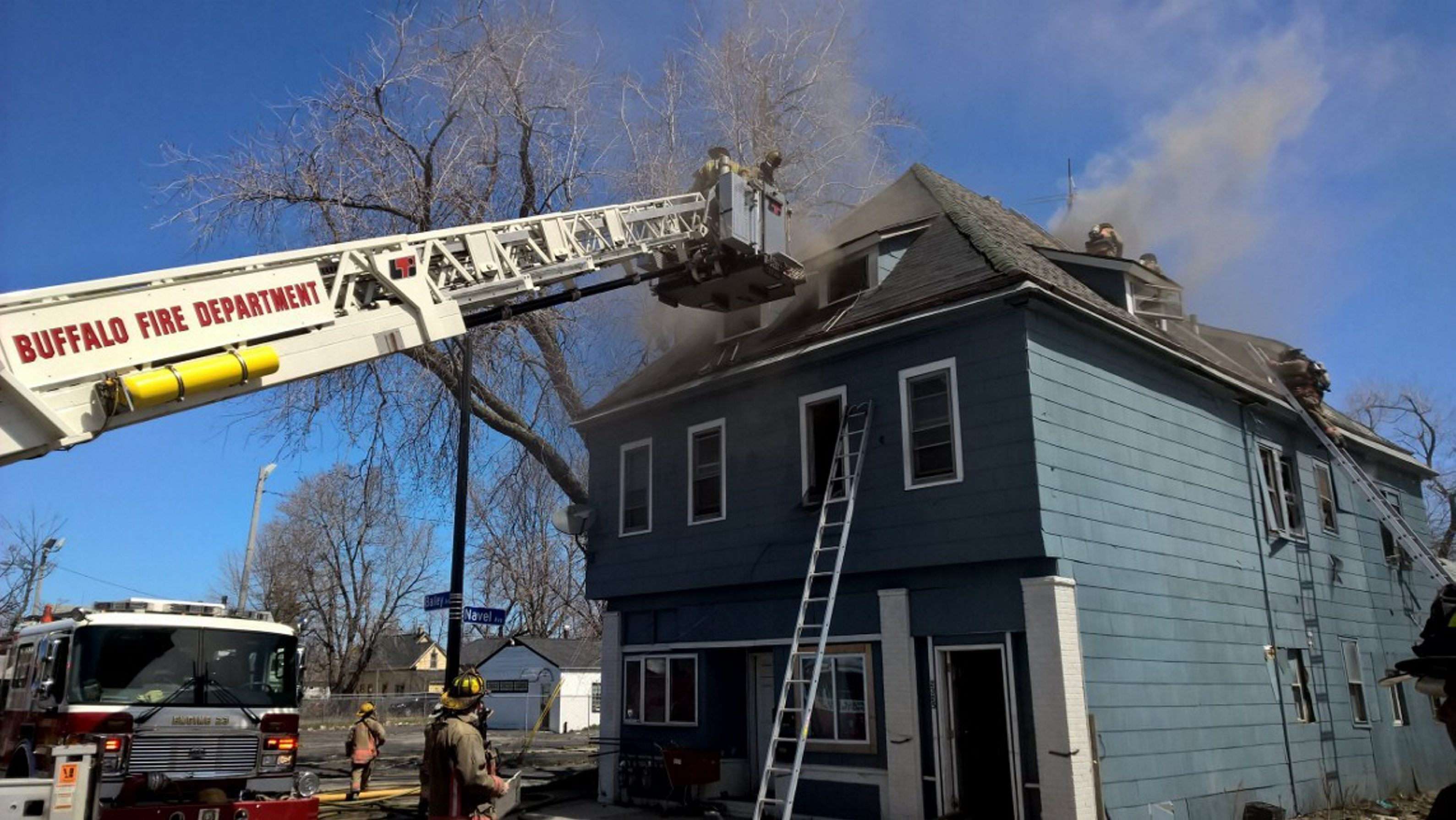 Buffalo firefighters at the scene of a house fire on Bailey Avenue Wednesday. (David Kazmierczak/Special to The Buffalo News)