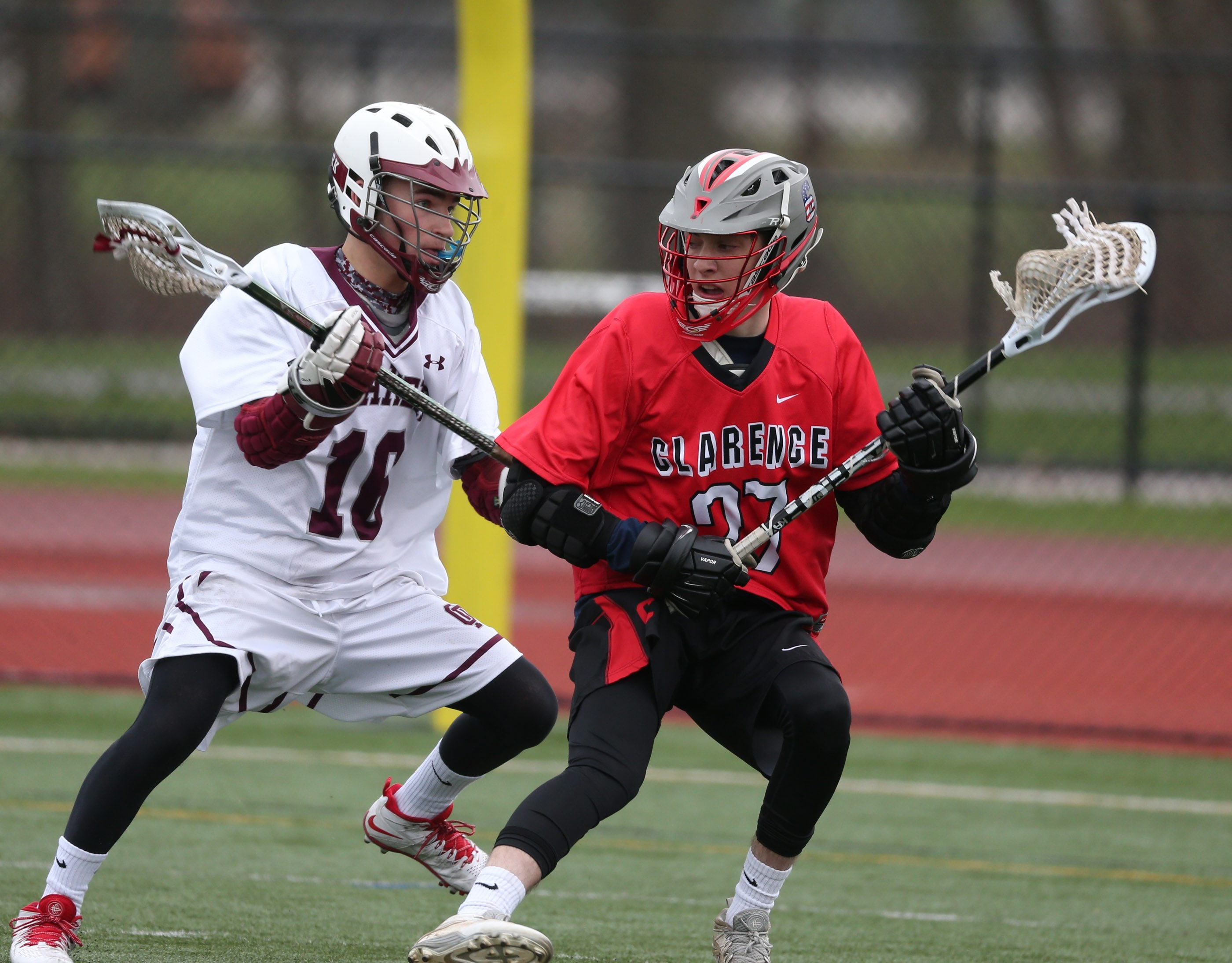 Orchard Park's Griffin Loughran battles Clarence's Riley Fitzhenry for the ball in the first half of their recent game. Both teams have undergone a shake-up, with their head coaches stepping down.