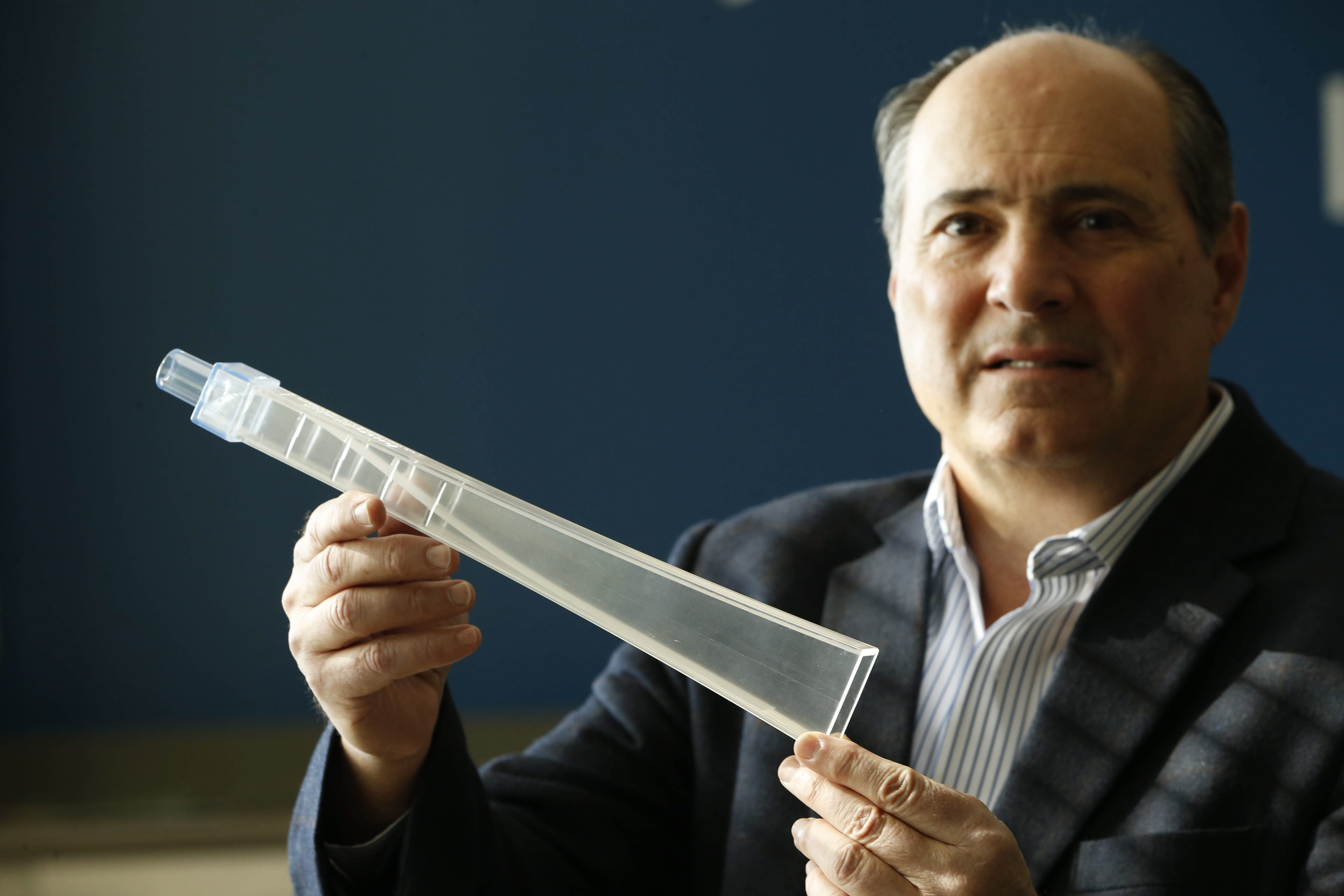 "Frank Codella, CEO of Medical Acoustics, holds up the ""lung flute"" his company makes and sells, headquartered in the Innovation Center, Friday, April 15, 2016. The device uses the vibration of a reed, just like a musical instrument, to loosen and remove material inside the lungs of patients with COPD and similar disorders. (Derek Gee/Buffalo News)"