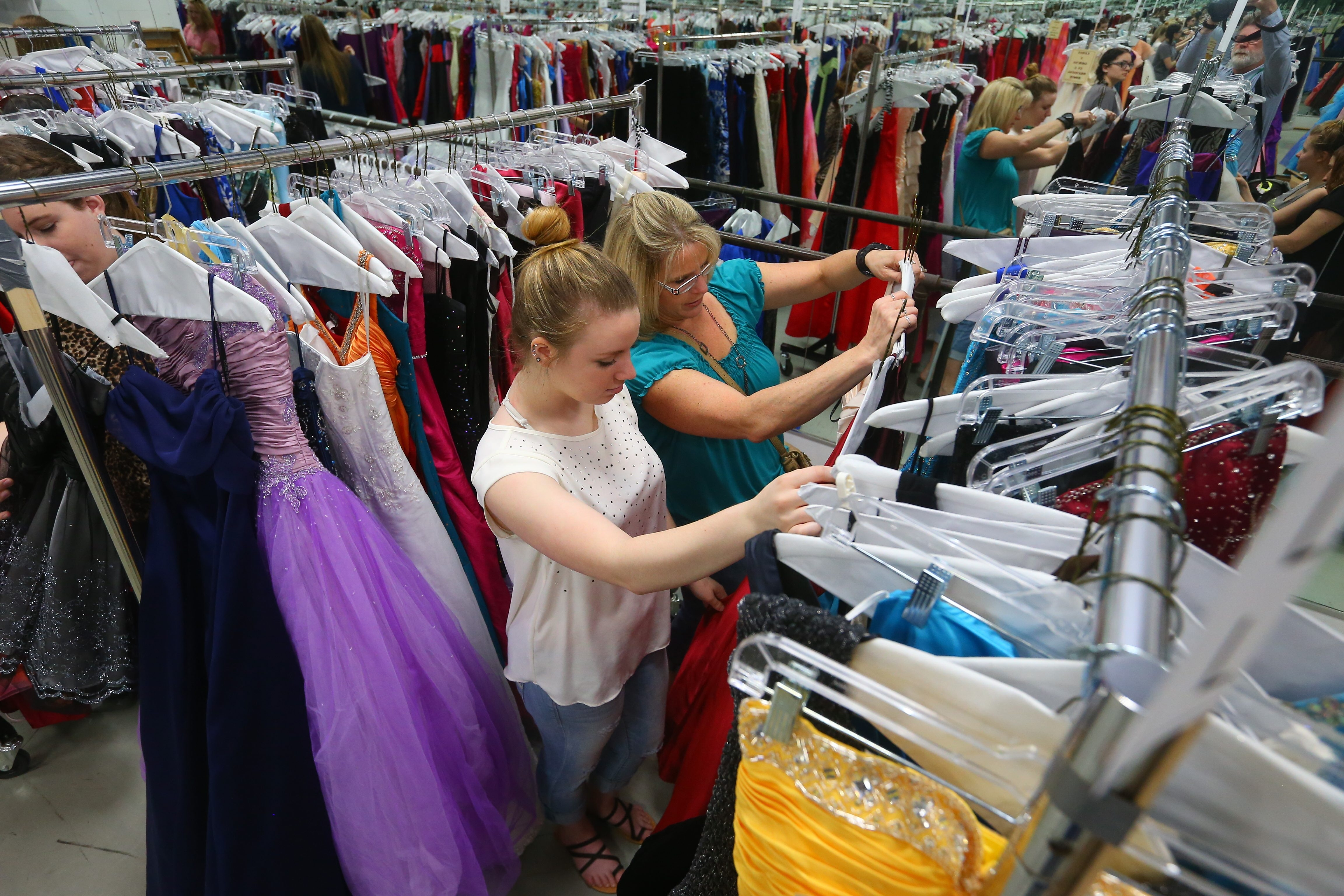 Julie Ambrose, of Hamburg, gets some help from her mother, Trish, picking out a free prom dress at Performing Arts Dance Academy in the Village of Hamburg on Sunday. More than 1,000 dresses – the most ever – were donated this year for the event.