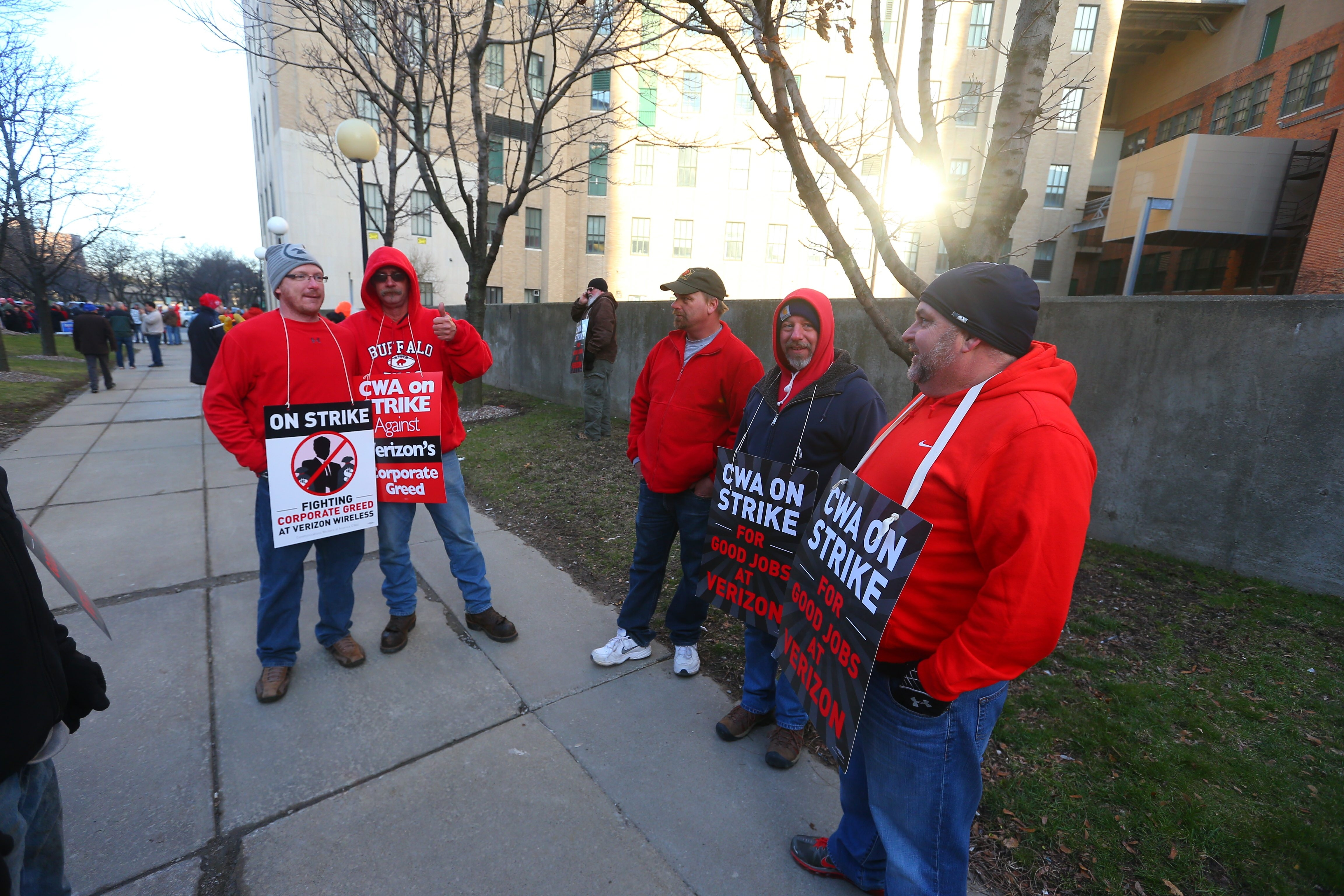 Verizon workers picket outside the company's central office in Buffalo on Wednesday, the first day of the strike that has idled about 40,000 workers across the company. It is the largest strike in the nation in five years, but still much smaller than earlier walkouts.