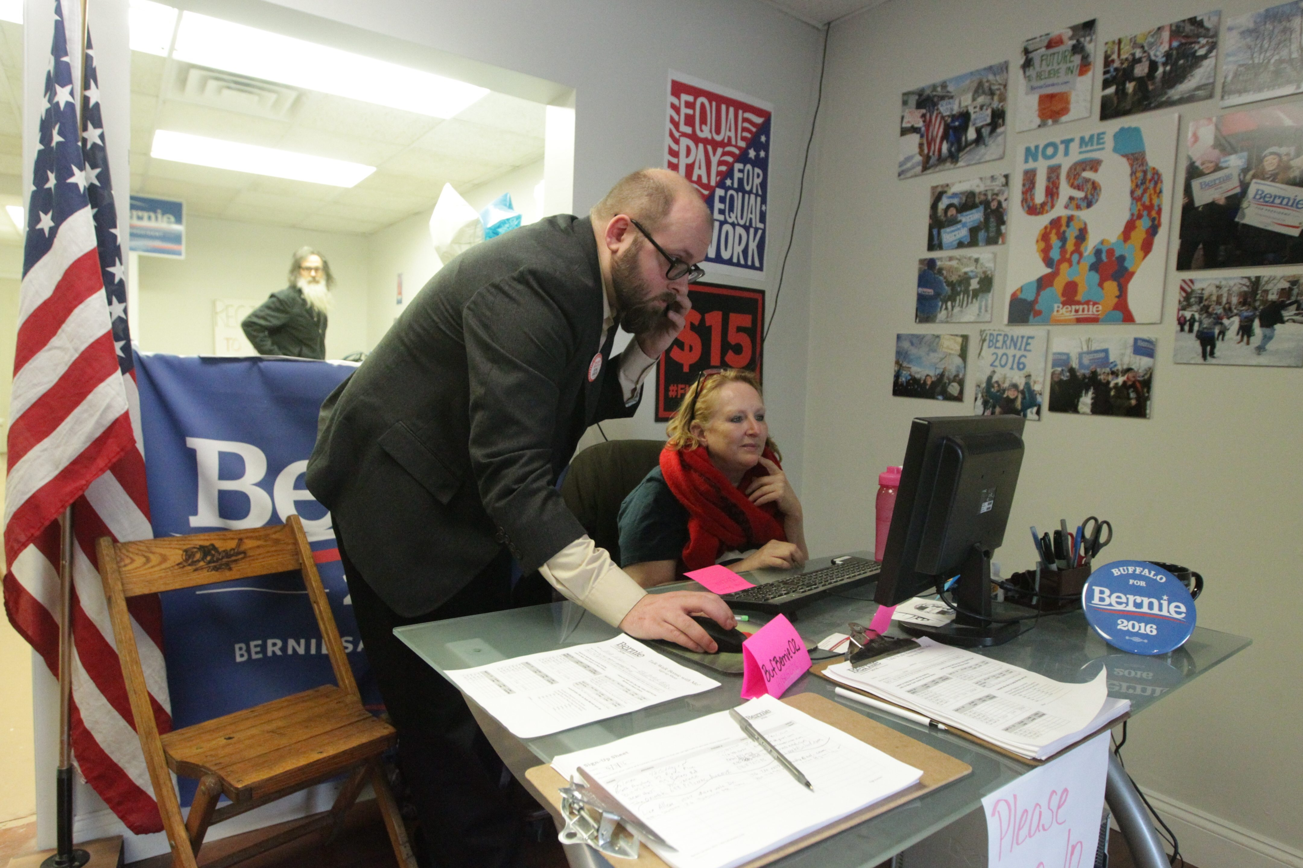Local Sanders' campaign coordinator Brian Nowak works with Lisa Allen of Cheektowaga at a phone bank where they will be recruiting volunteers and spreading Sanders' message.