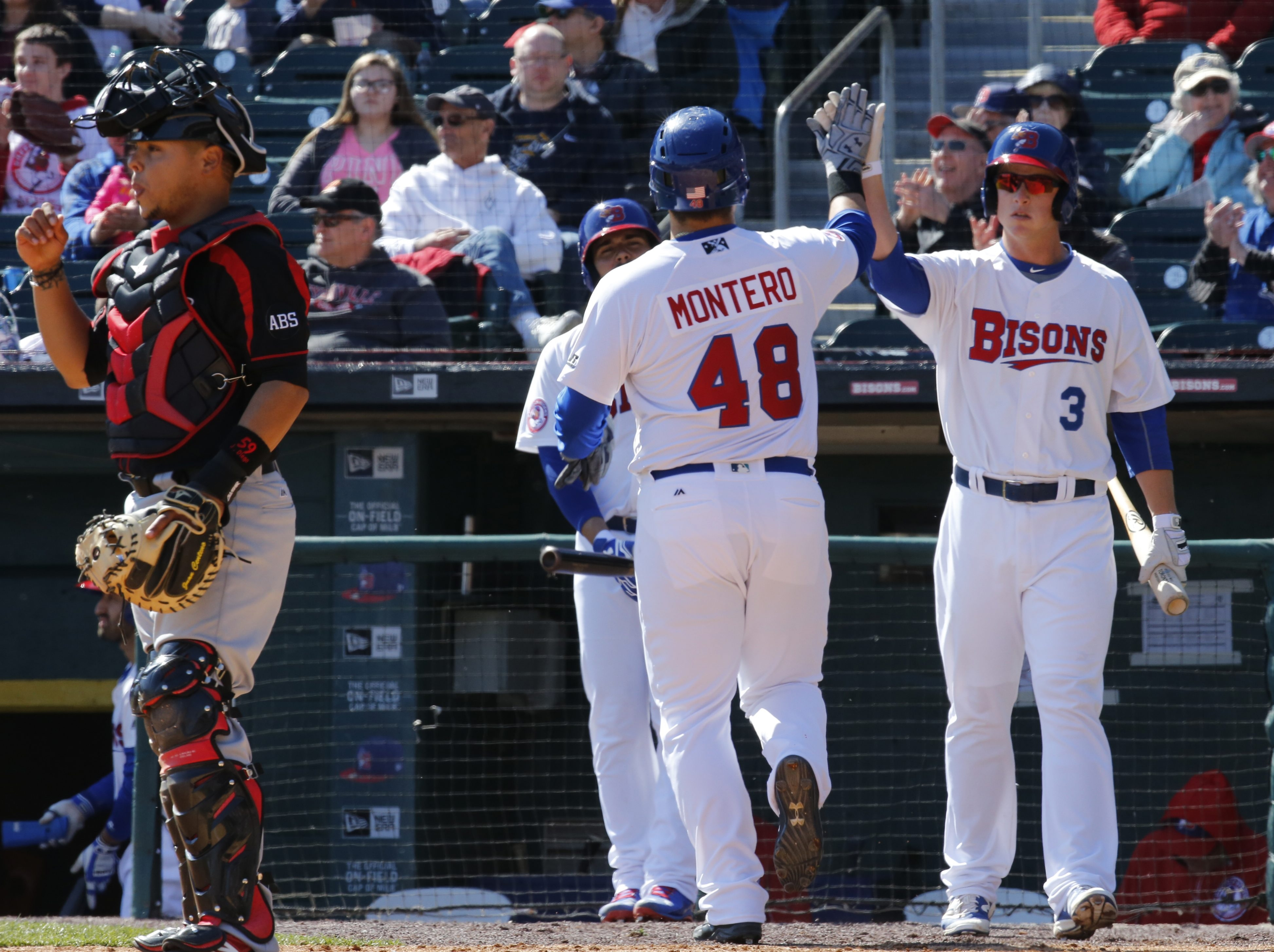 Jesus Montero of the Bisons comes home with the go-ahead run on a double by teammate Junior Lake in the seventh inning. Lake said he made adjustments at the plate against Red Wings starter Pat Dean.