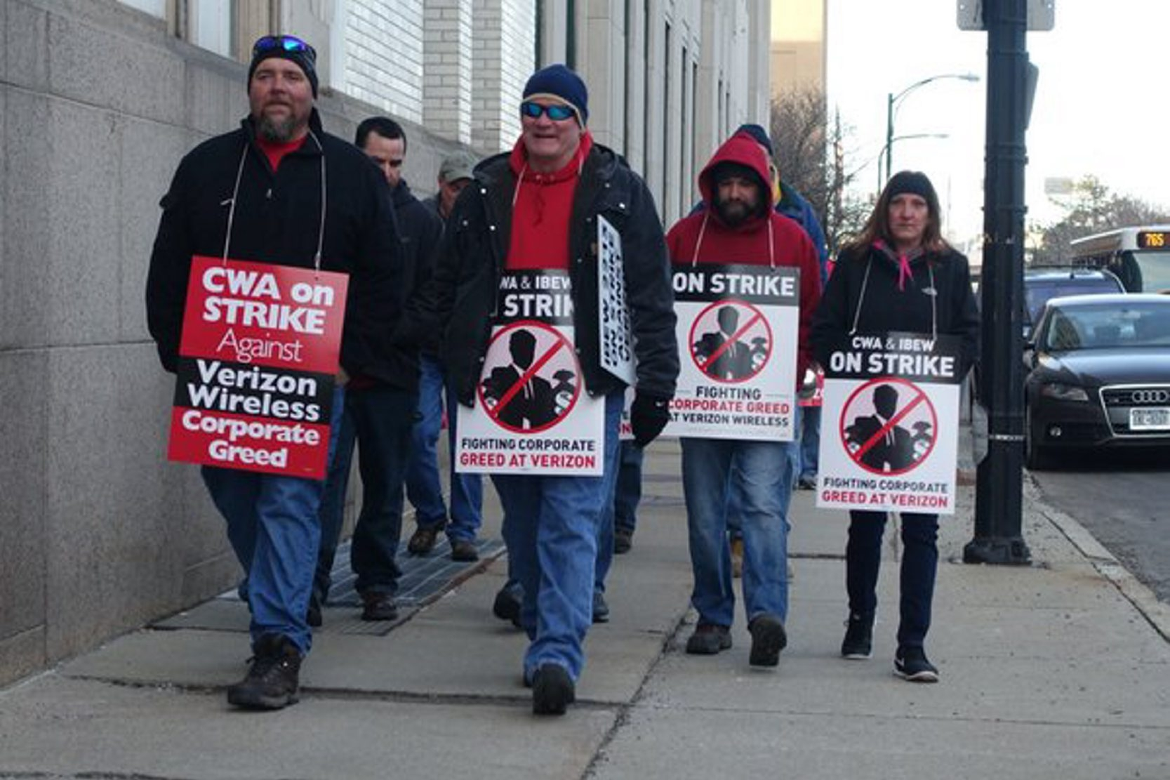 Union members walk picket line outside the central office of Verizon Communications in downtown Buffalo as Communications Workers of America and International Brotherhood of Electrical Workers start strike eight months after their contract expired.