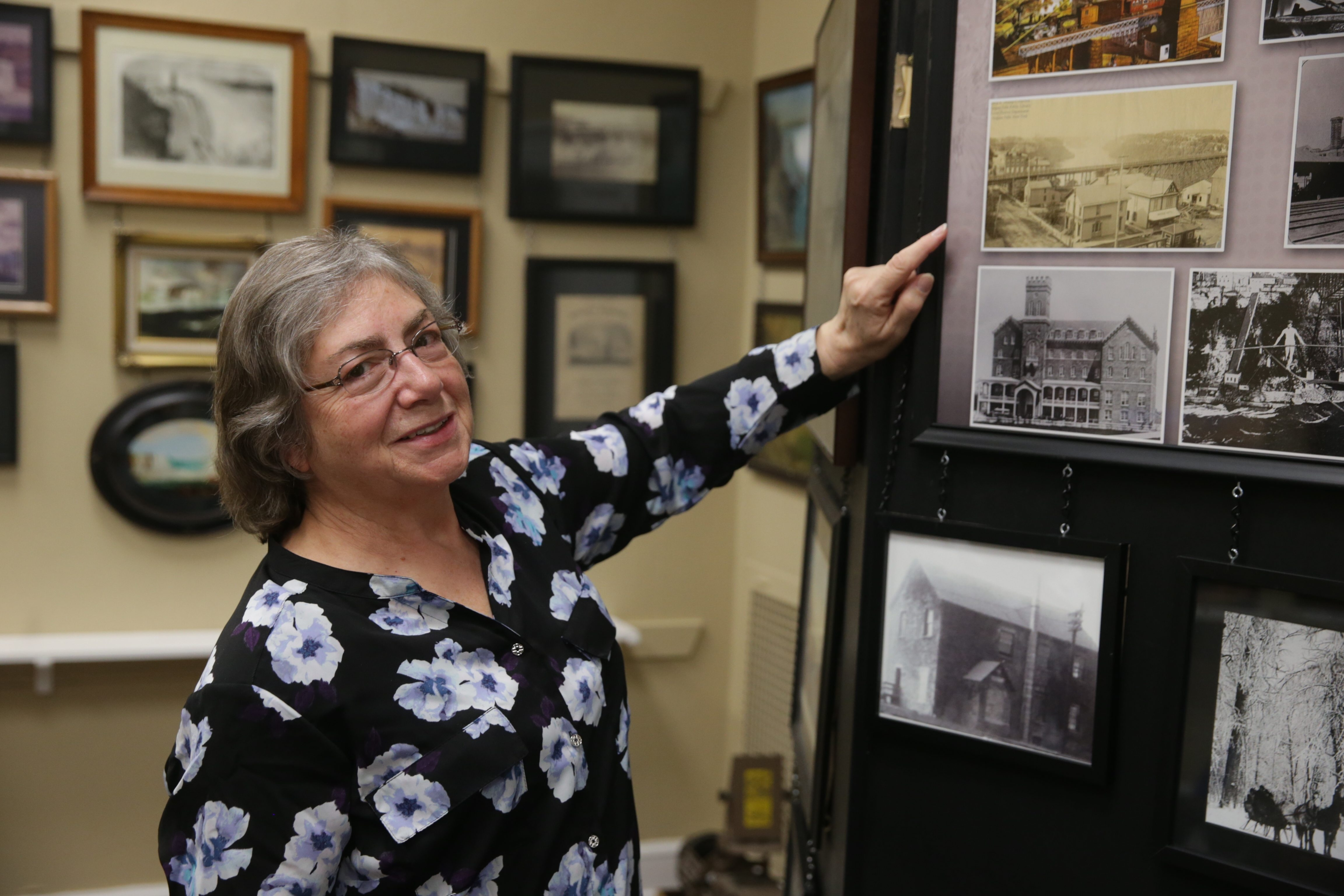 Niagara Falls historian Elaine Timm, points out a photograph in the Niagara Arts and Cultural Center.