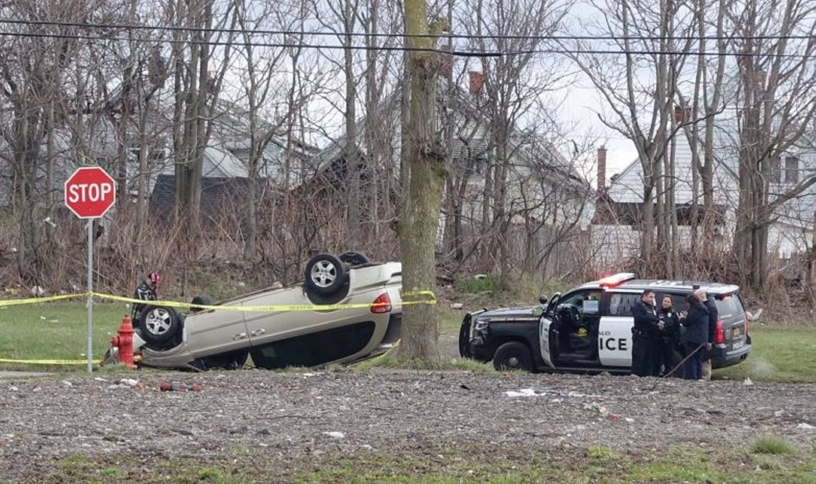 Buffalo Police at the scene of an overturned vehicle and reports of shots fired on Wick Street by Brier Street.