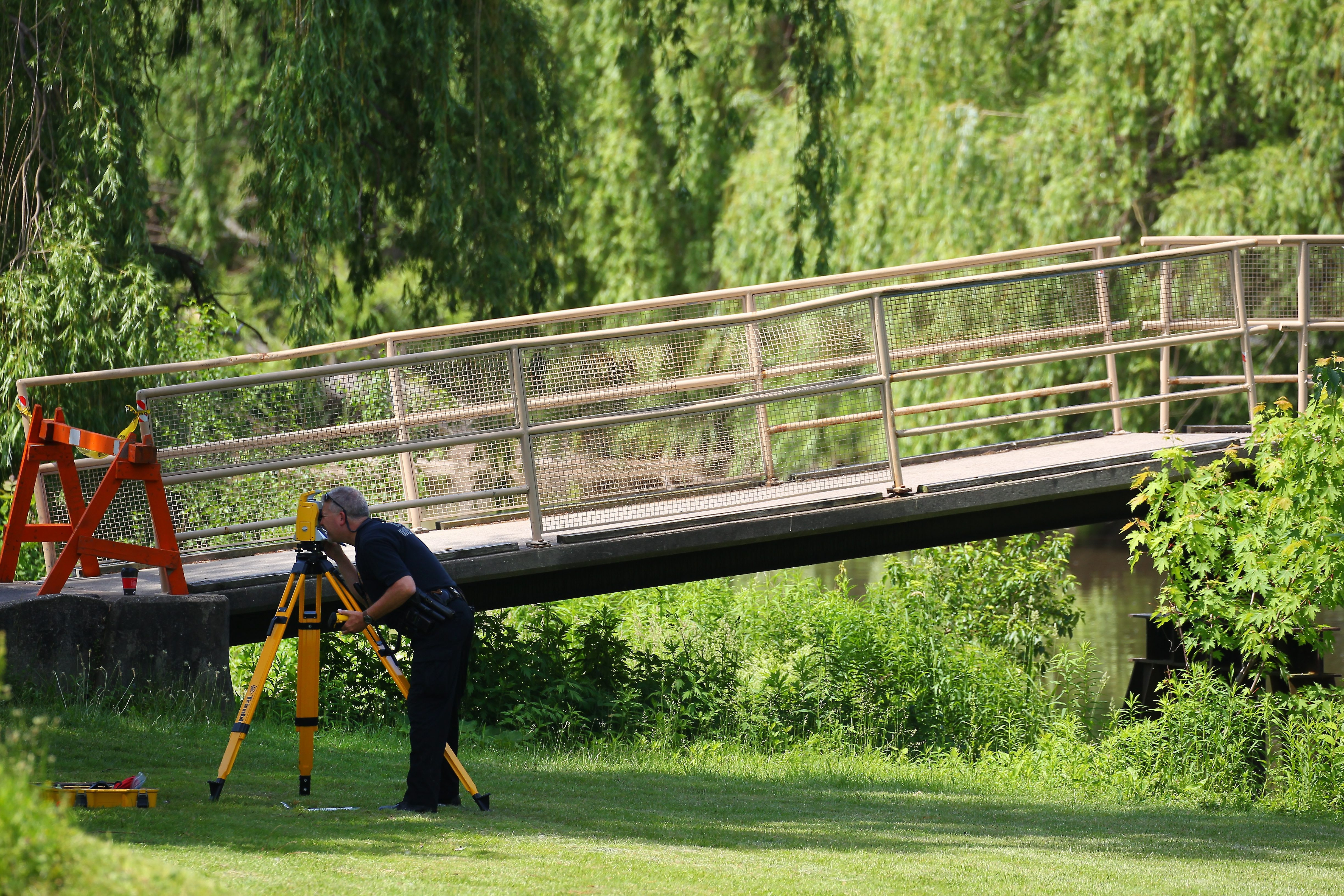 This 2015 photo shows police investigating near the foot bridge where Avery Gardner died in a boating accident. (Mark Mulville/News file photo)
