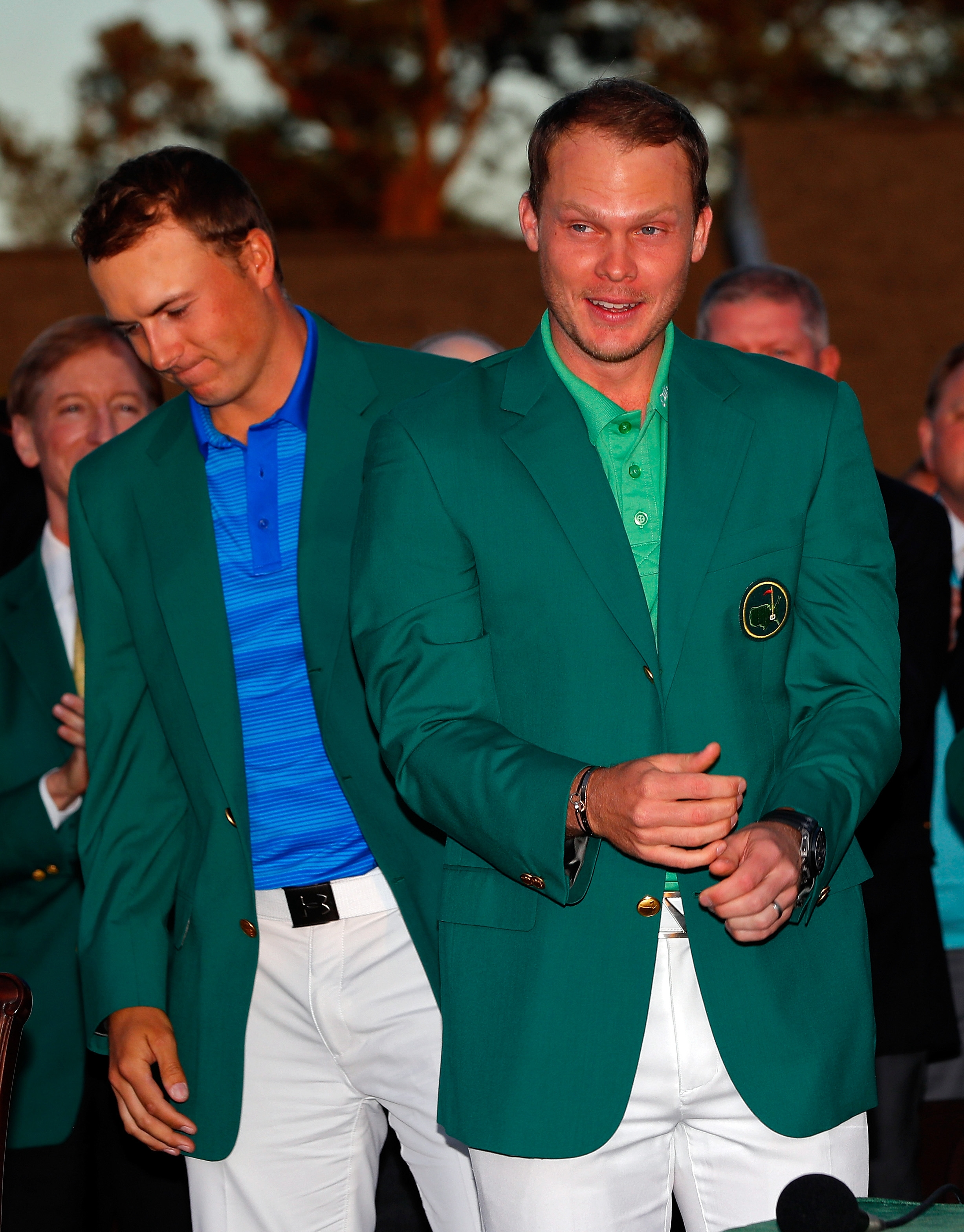 Jordan Spieth presents Danny Willett of England with the green jacket at the Masters.