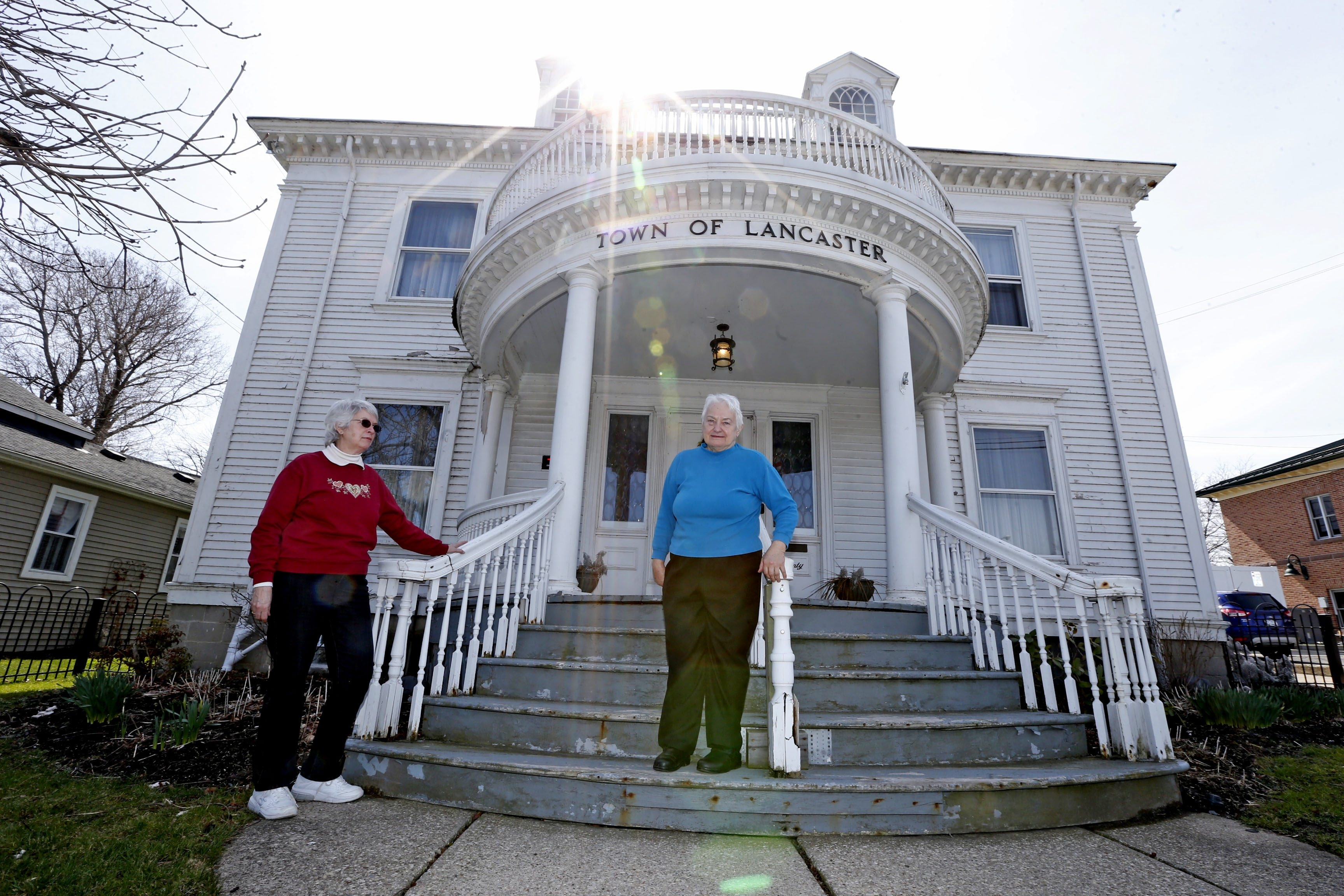 """Marie Schu, left, secretary of Lancaster Historical Society, and Terry Wolfe, vice president, are in the forefront of those urging the town to restore the long-deteriorating 121-year-old building on Clark Street. """"It belongs to the town,"""" Wolfe says, """"and the town should fix it."""""""