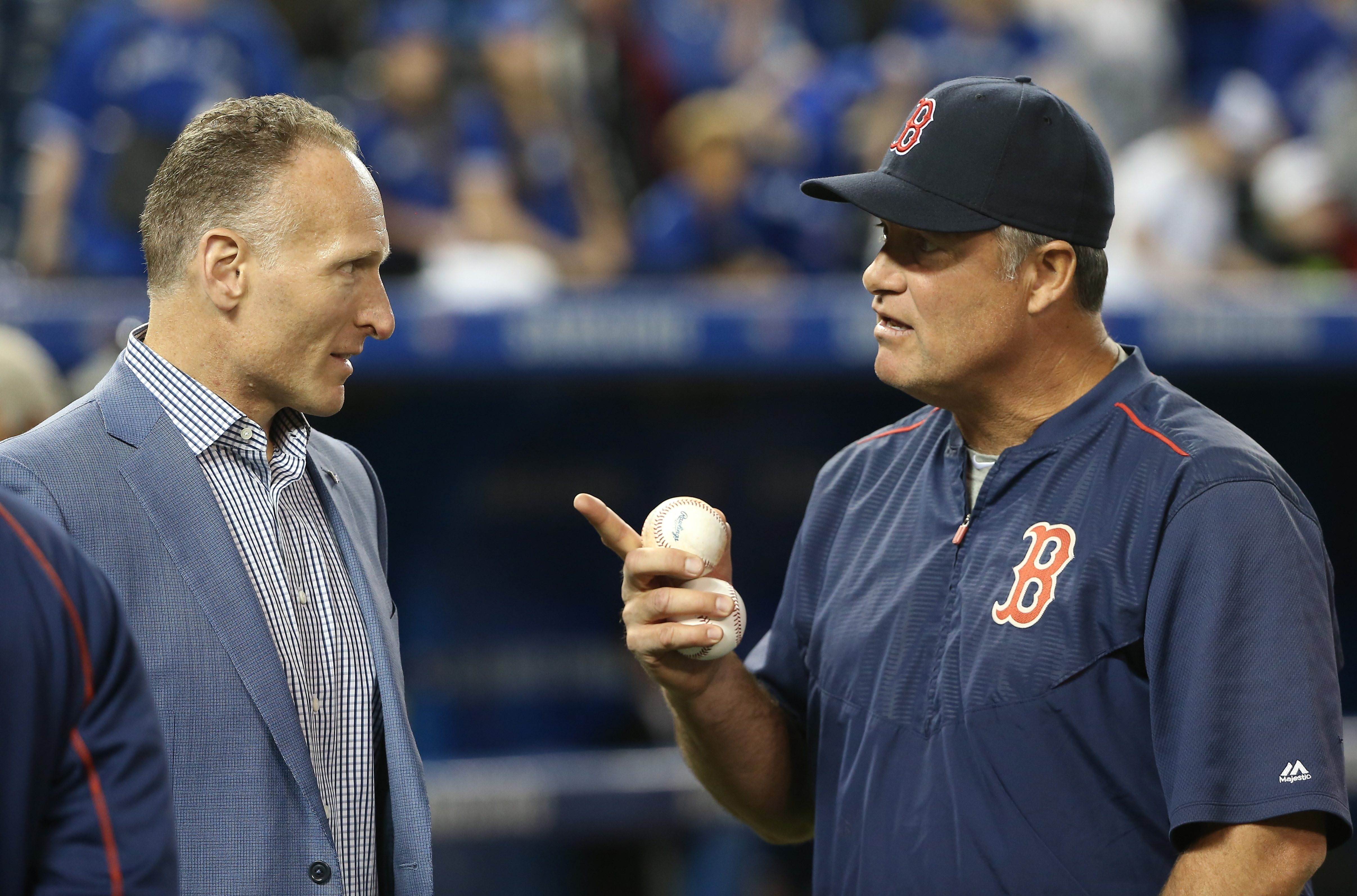 Toronto Blue Jays President and CEO Mark Shapiro talks to manager John Farrell of the Red Sox Friday.