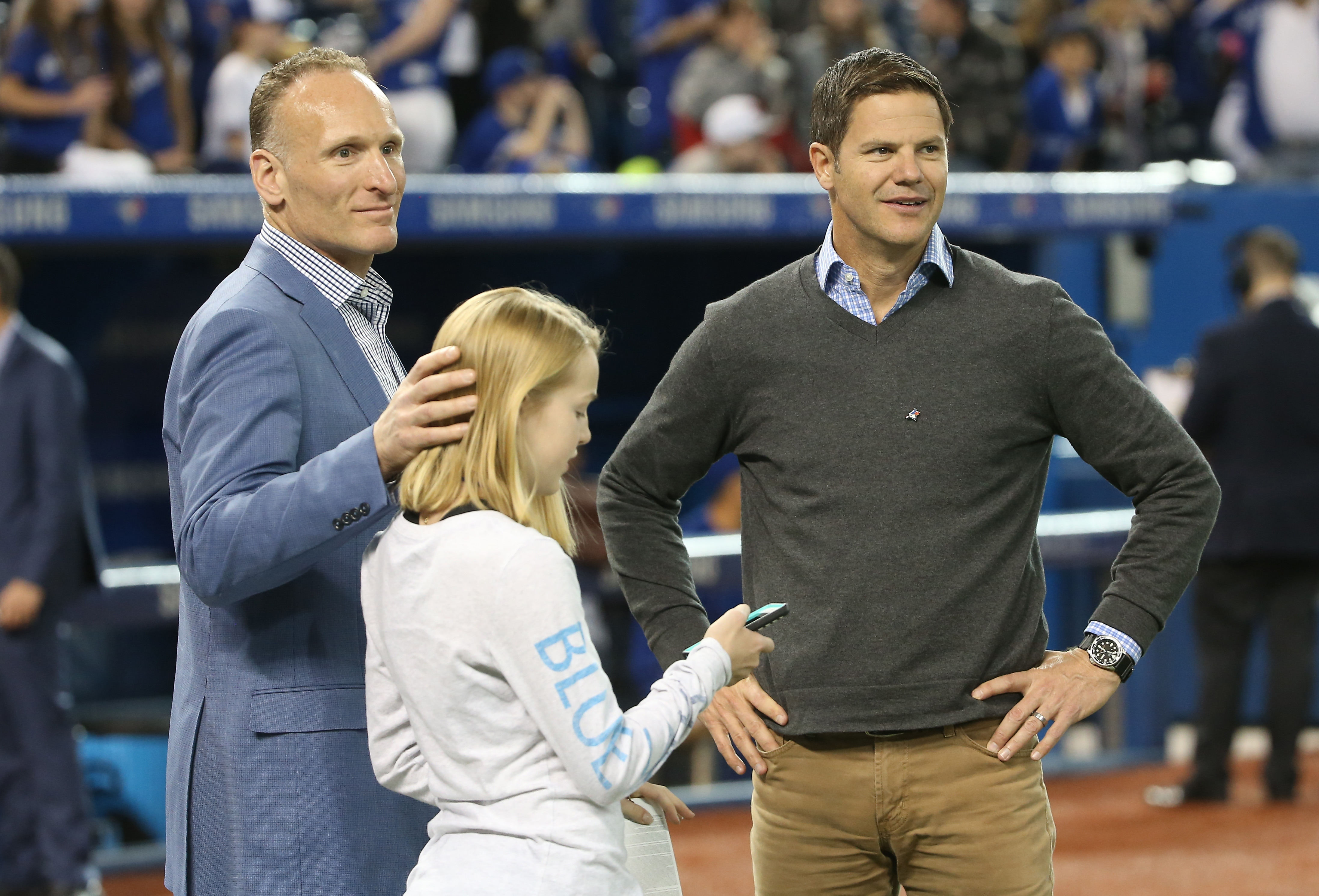 President and CEO Mark Shapiro of the Toronto Blue Jays with his daughter Sierra and General Manager Ross Atkins visit the field before the start of Friday's game.