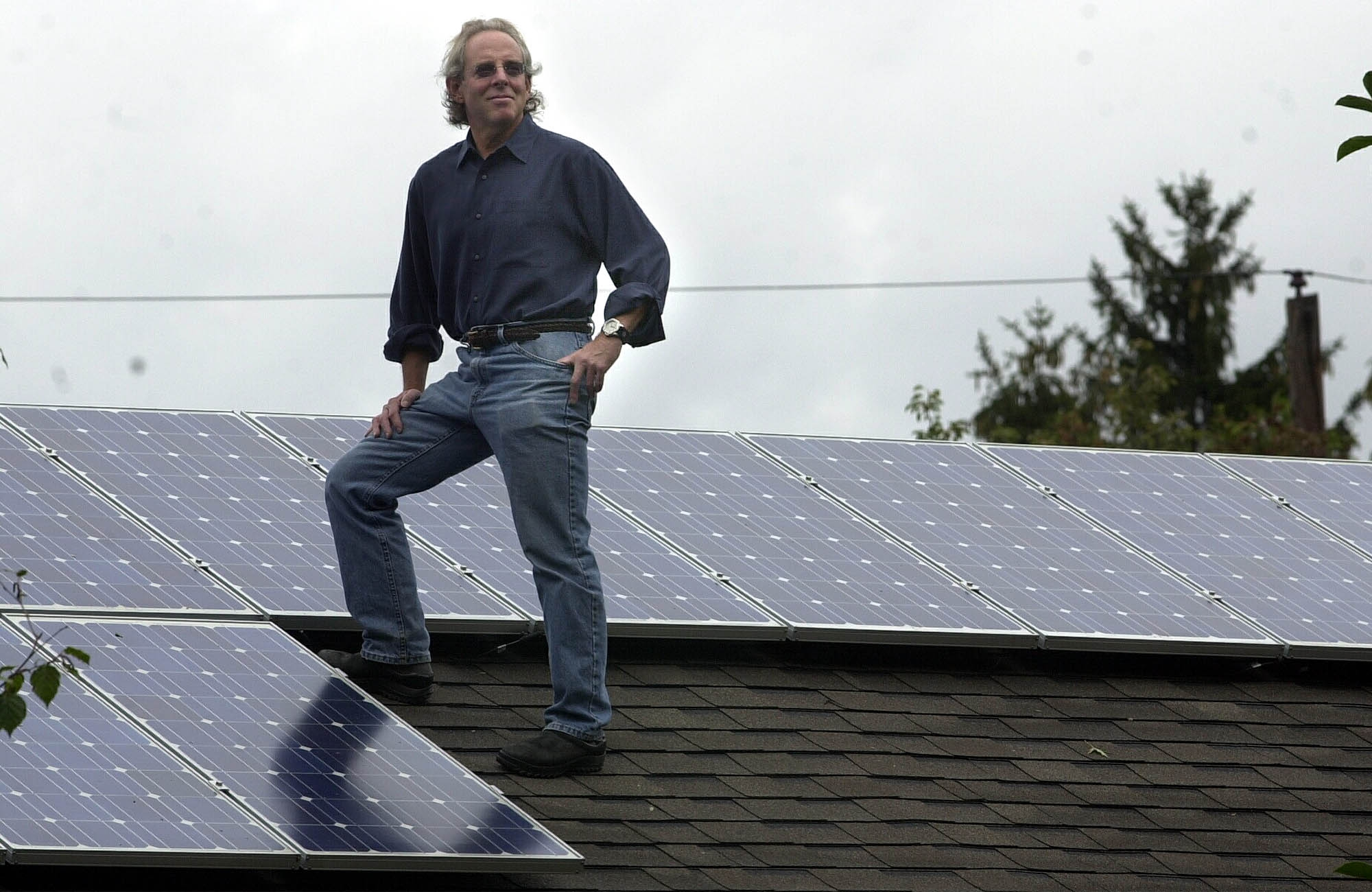 Richard Bergman on the roof of his Amherst home amid solar panels. A new study shows WNY is a good fit for solar development.