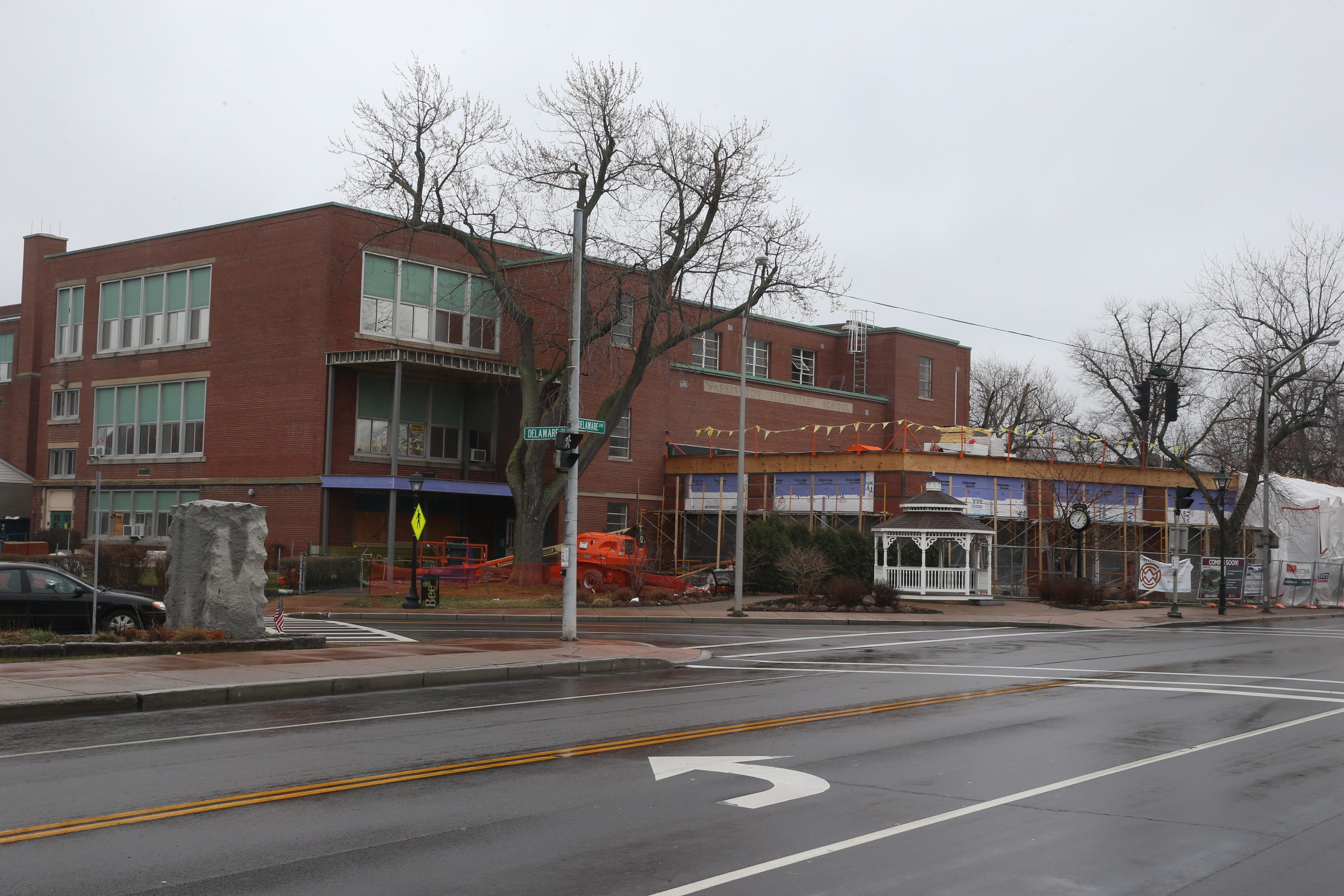 The former Washington School in Kenmore is being converted to a mixed-use building, including luxury apartments, Agave Mexican restaurant and a just-announced SPoT Coffee shop.