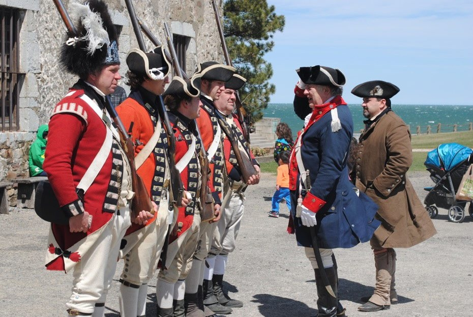 Old Fort Niagara's British Redcoats meet face-to-face with an officer of the Continental Army, portrayed by event organizer Tommy Thompson of Hoisington's New York Rangers, and an American militiaman, portrayed by Tony Consiglio, also of Hoisington's.