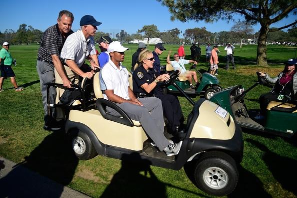 Tiger Woods leaves the course after injury forced him out of the Farmers Insurance Open at Torrey Pines on Feb. 5, 2015. Woods hasn't won a major since taking the U.S. Open at Torrey Pines in 2008. (Getty Images)