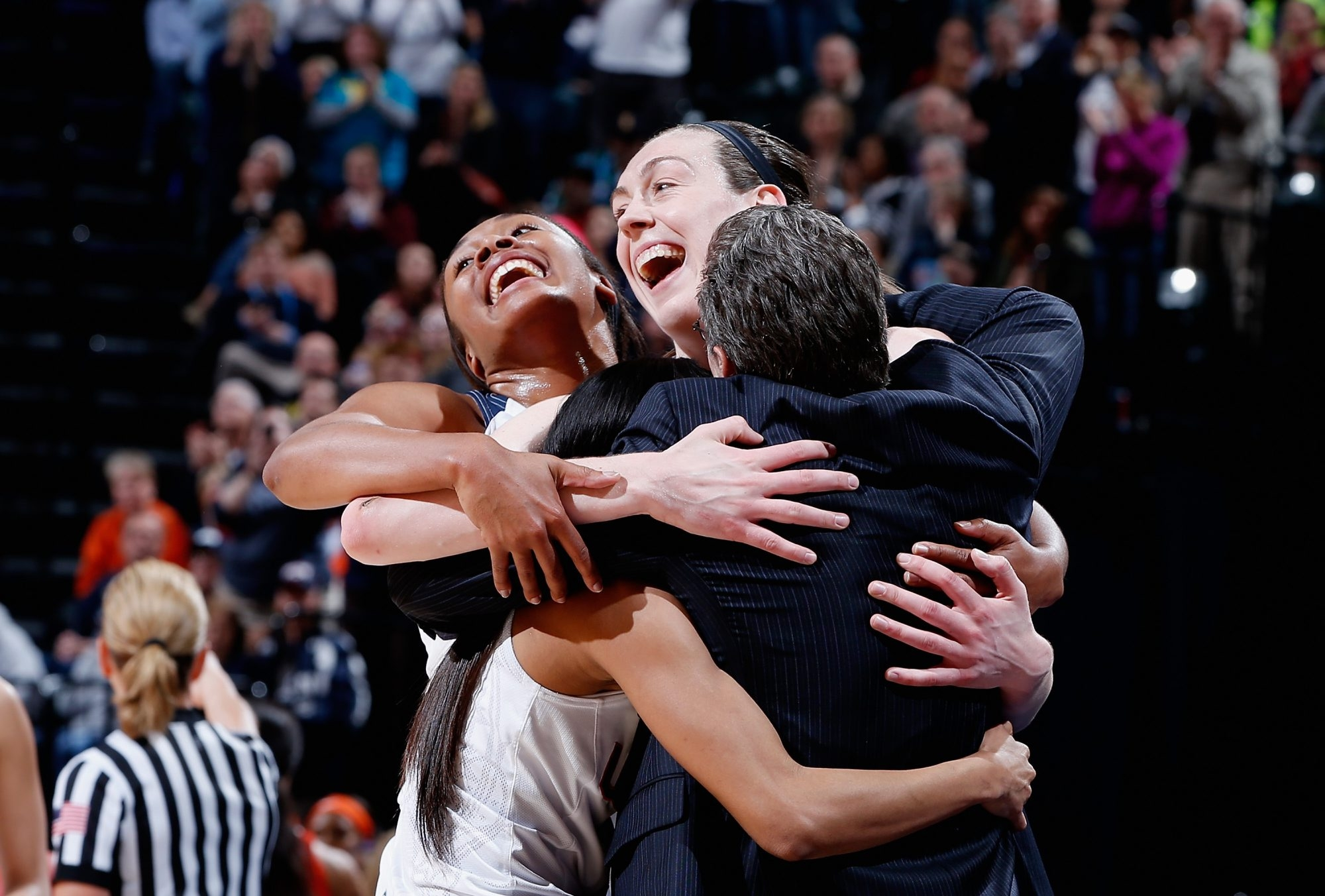Breanna Stewart, Morgan Tuck, Moriah Jefferson and head coach Geno Auriemma hug as the starters leave the game in the fourth quarter of the Huskies' 82-51 victory over Syracuse Tuesday in Indianapolis.
